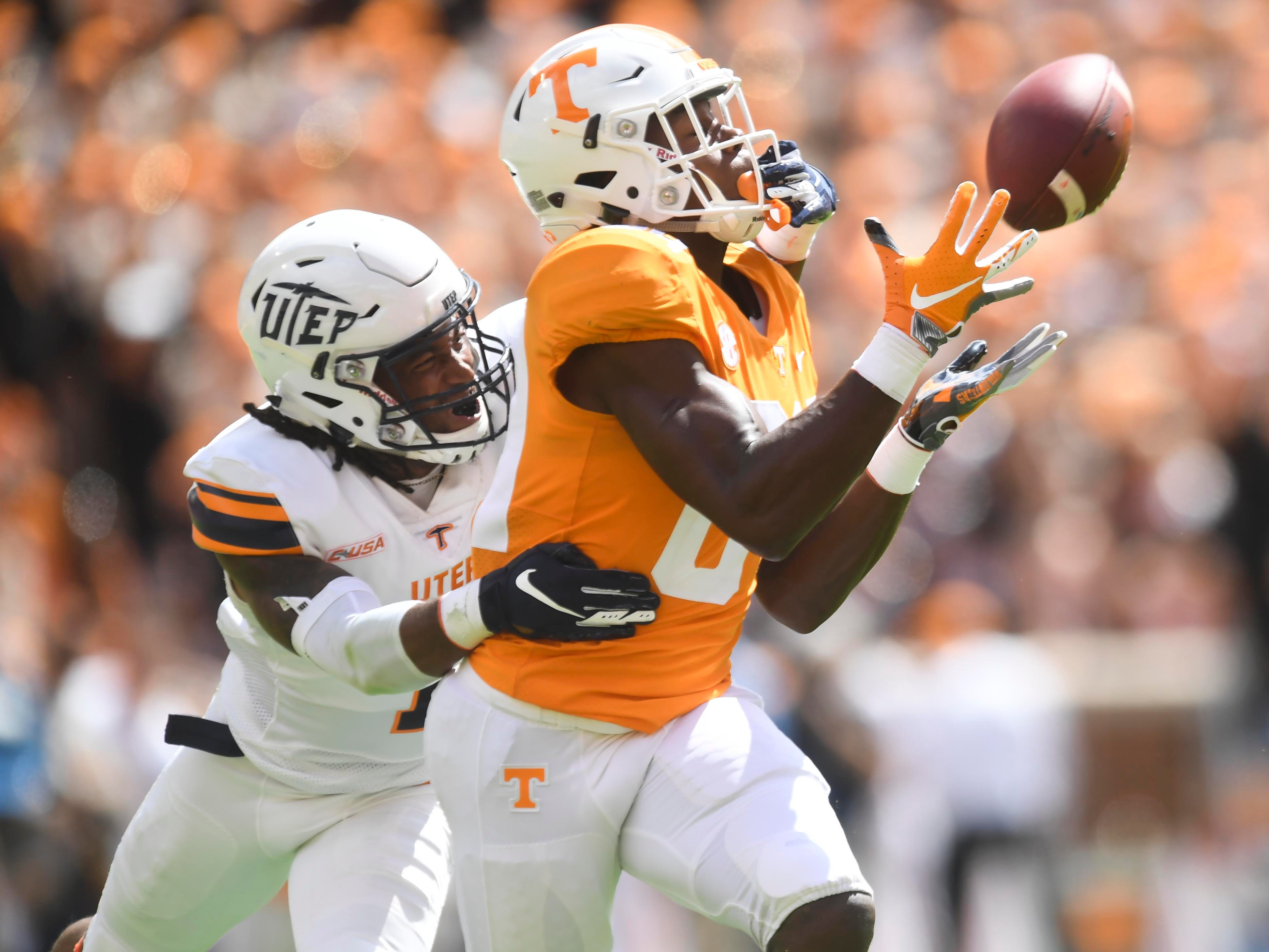 The ball drops into Tennessee wide receiver Josh Palmer's (84) hands while defended by UTEP defensive back Kalon Beverly (1) on Saturday, September 15, 2018.