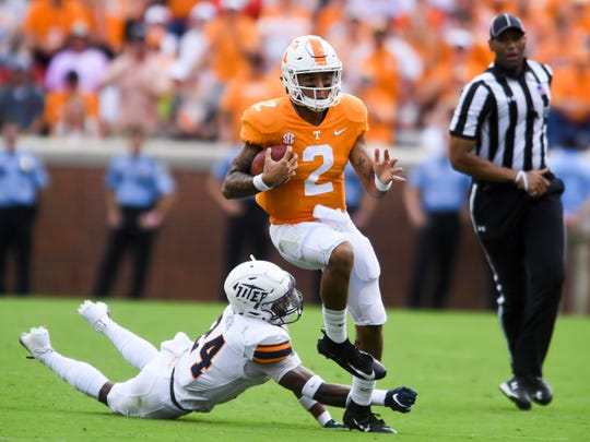Tennessee quarterback Jarrett Guarantano (2) gets past UTEP defensive back Kahani Smith (24) on Saturday, September 15, 2018.