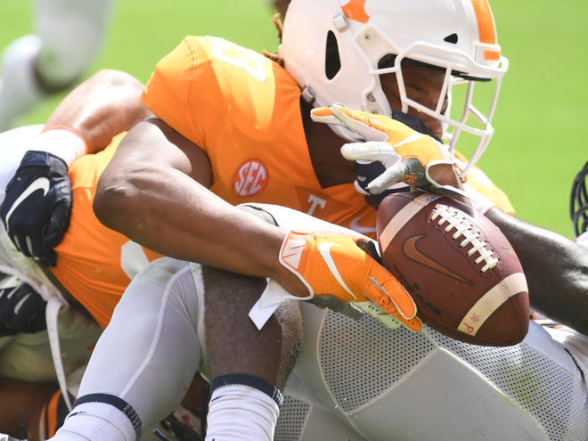 Tennessee running back Jeremy Banks (33) fumbles the ball at the 1-yard line in the game against UTEP on Saturday, September 15, 2018.