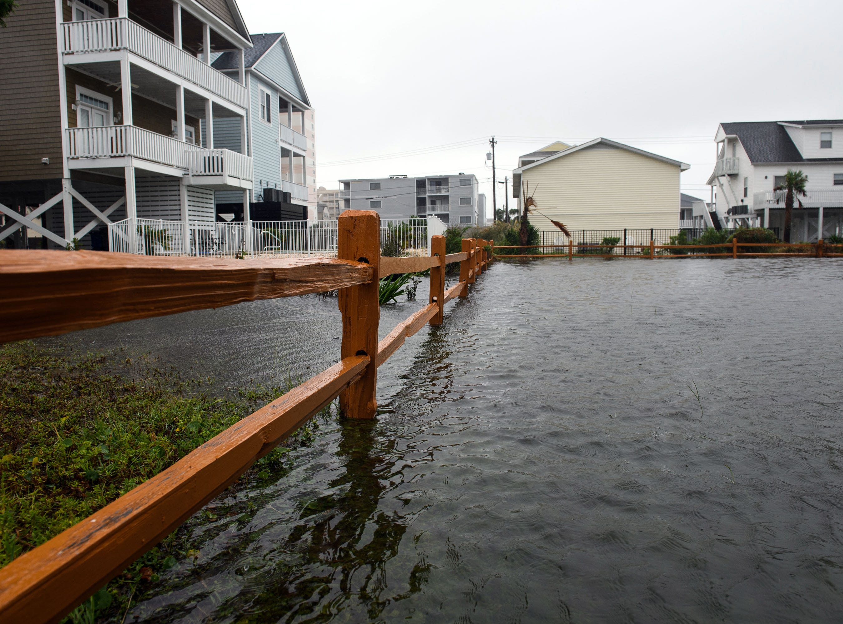 September 15, 2018; North Myrtle Beach, SC, USA; The yard of a home is flooded in the Cherry Grove neighborhood in North Myrtle Beach on Saturday, Sept. 15, 2018..