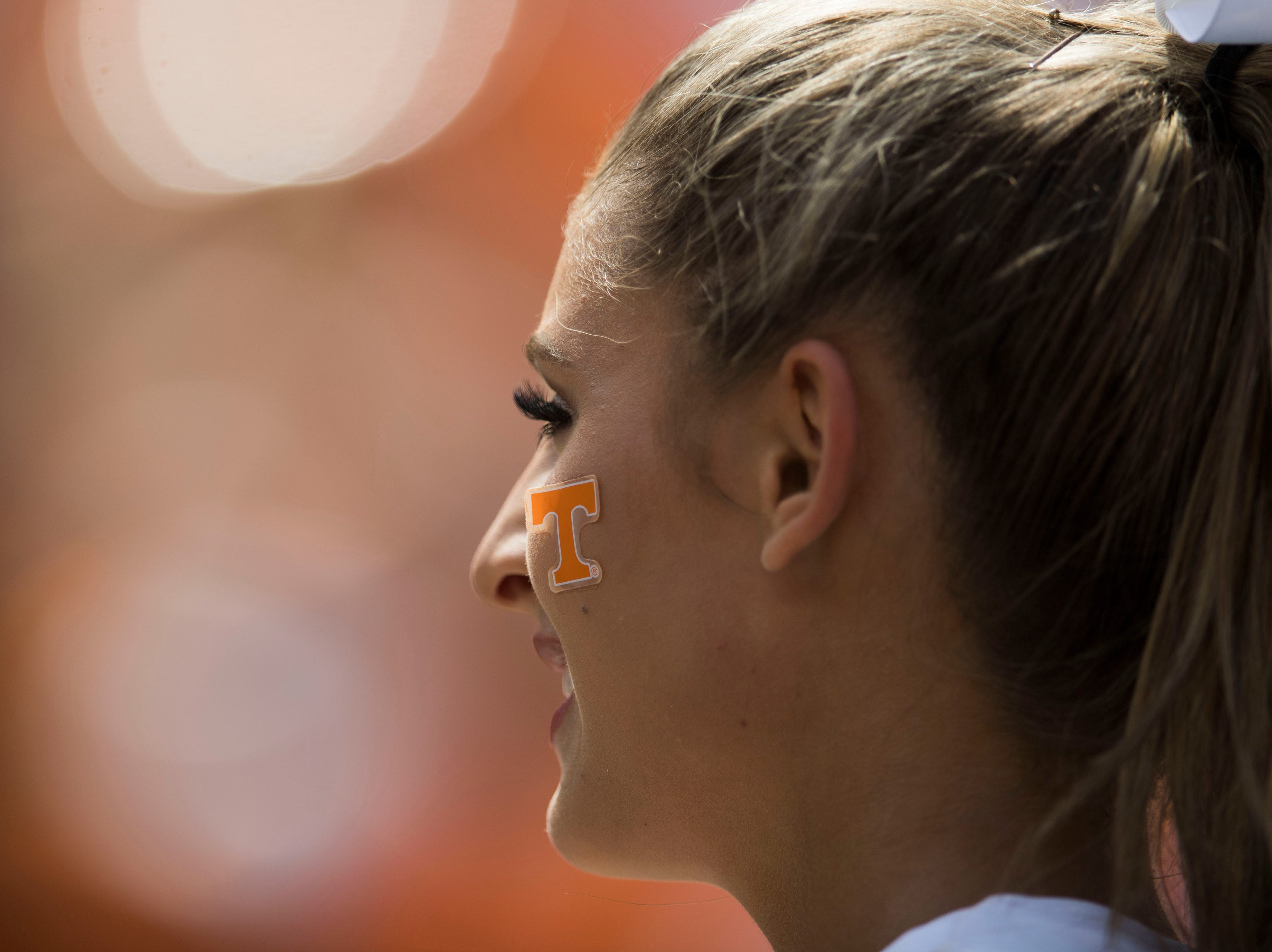 A UT cheerleader smiles during the second half of a game between UT and UTEP in Neyland Stadium Sept. 15, 2018.