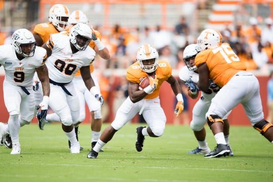 Tennessee running back Ty Chandler (8) runs the ball during a game between UT and UTEP in Neyland Stadium Sept. 15, 2018.