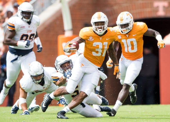 Tennessee running back Madre London (31) runs down the field against UTEP on Saturday.