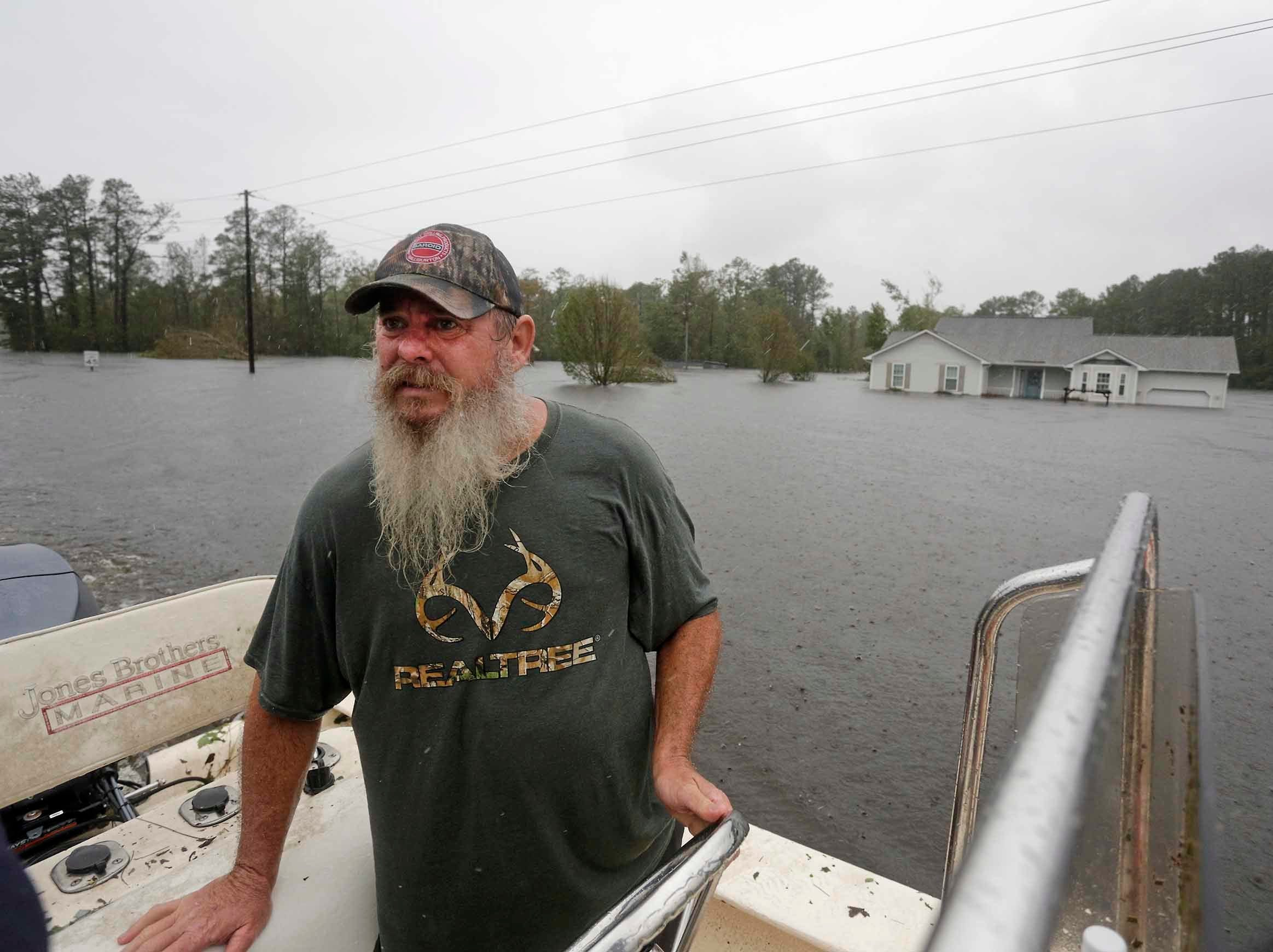 Danny Hill drives his boat past his home, right, on Mill Creek Road after Hurricane Florence hit Newport N.C., Saturday, Sept. 15, 2018.