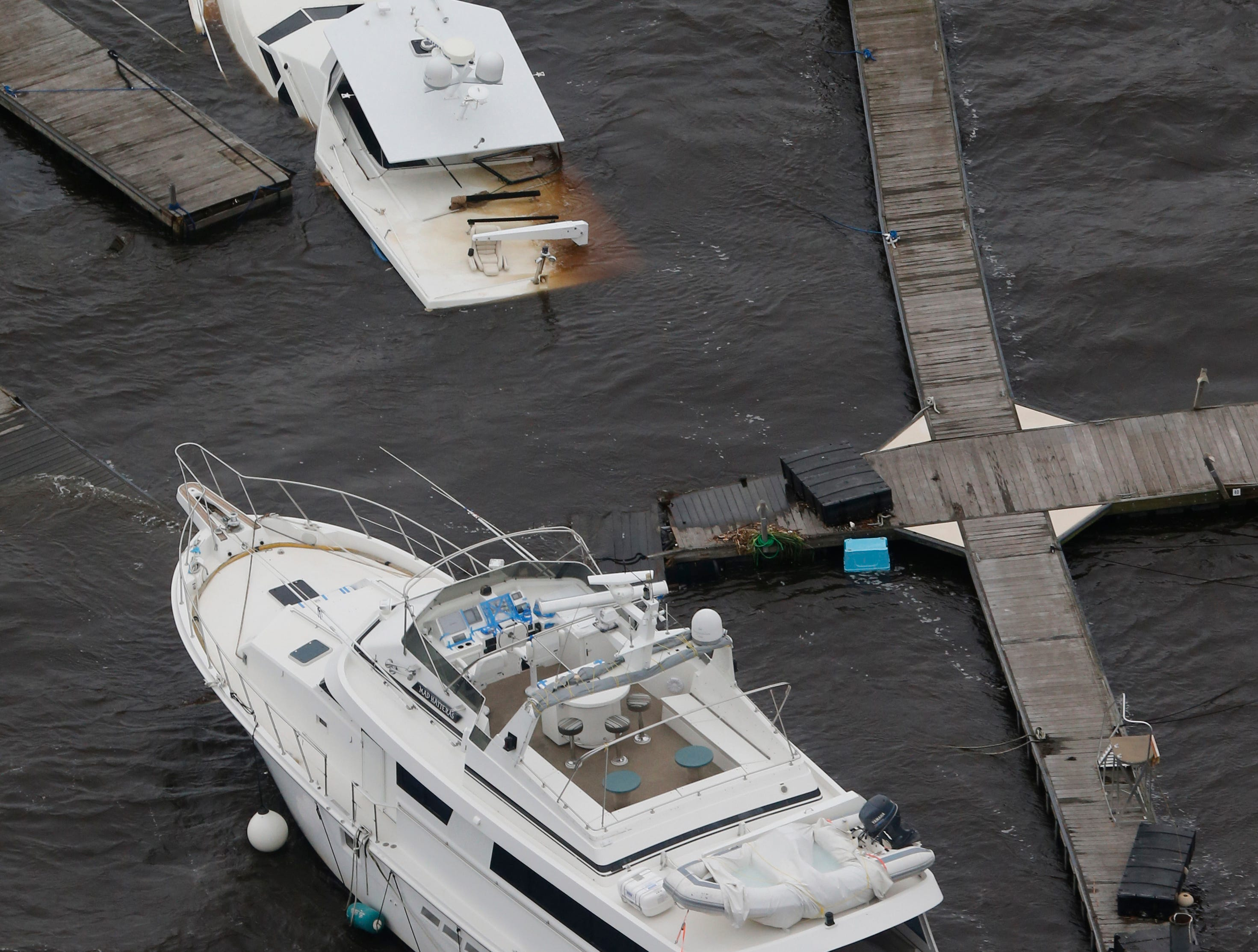 This aerial photo shows Sunken boats and broken docks from Florence, now a tropical storm, in New Bern, N.C., Saturday, Sept. 15, 2018.