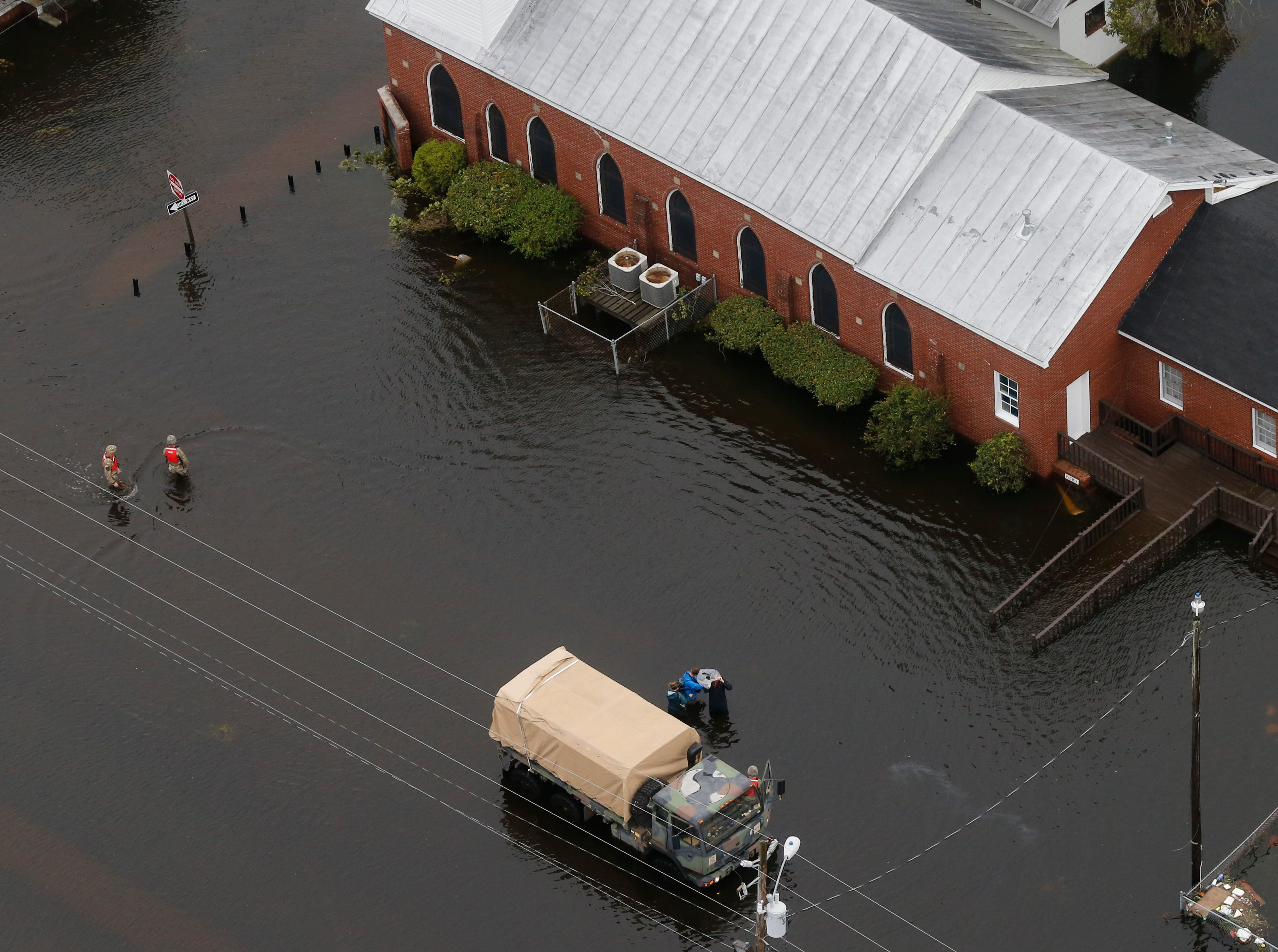 Rescue personnel check a church checking for flood victims in New Bern, NC., Saturday, Sept. 15, 2018.