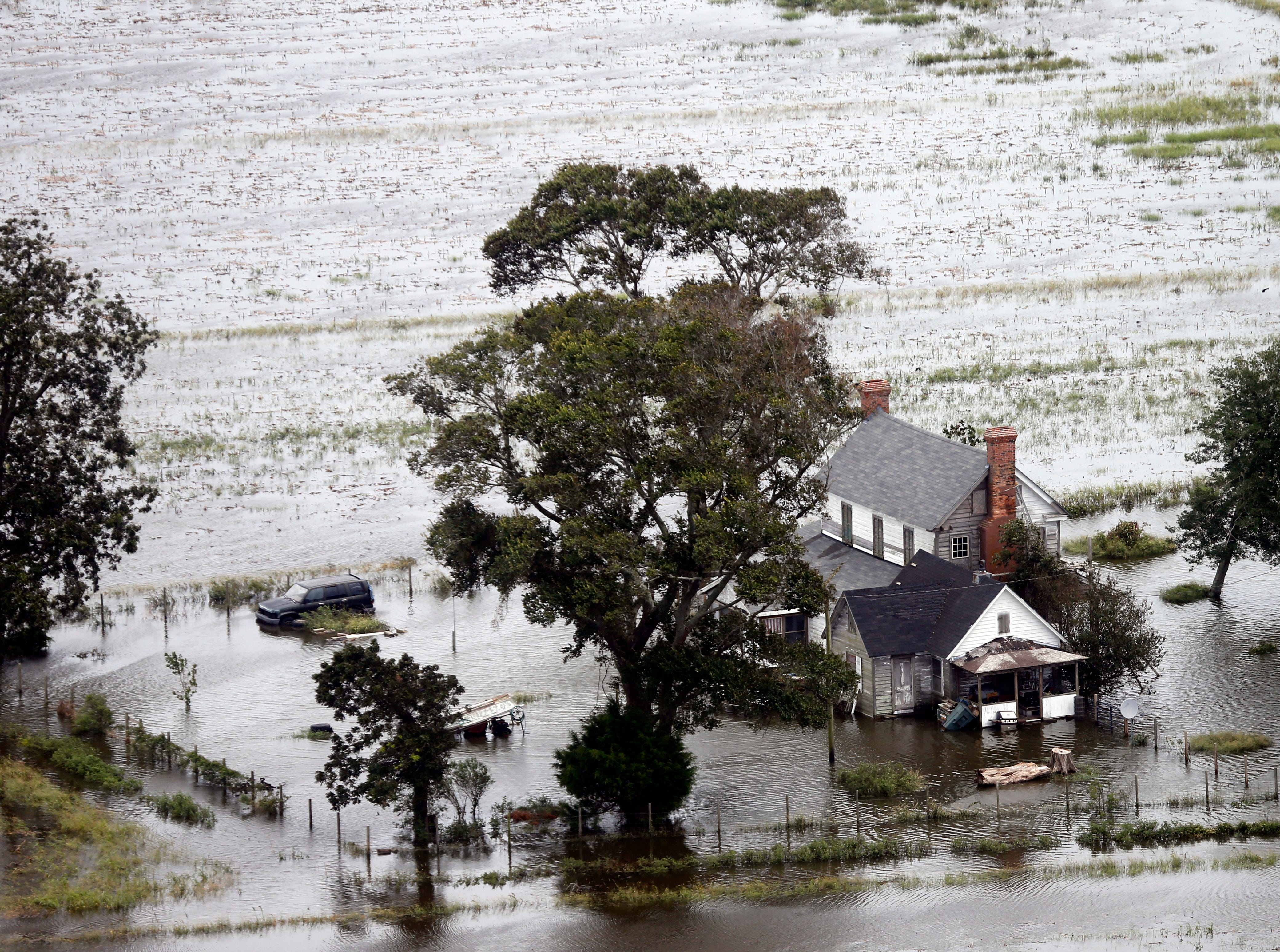 A farm house is surrounded by flooded fields in Hyde County, NC., Saturday, Sept. 15, 2018.