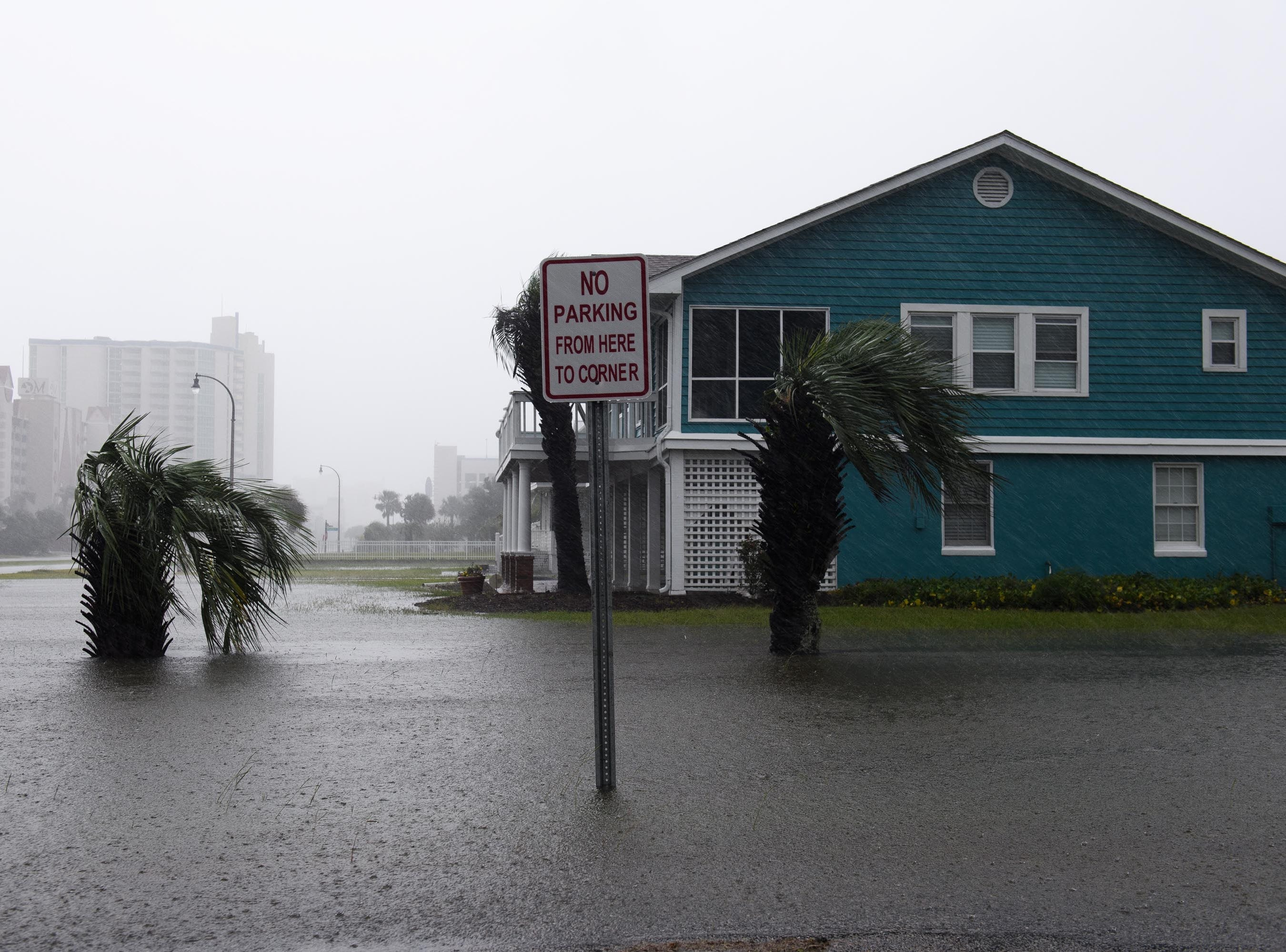 Sep 15, 2018; Myrtle Beach, SC USA; The yard of a home is flooded in the Cherry Grove neighborhood in North Myrtle Beach on Saturday, Sept. 15, 2018.