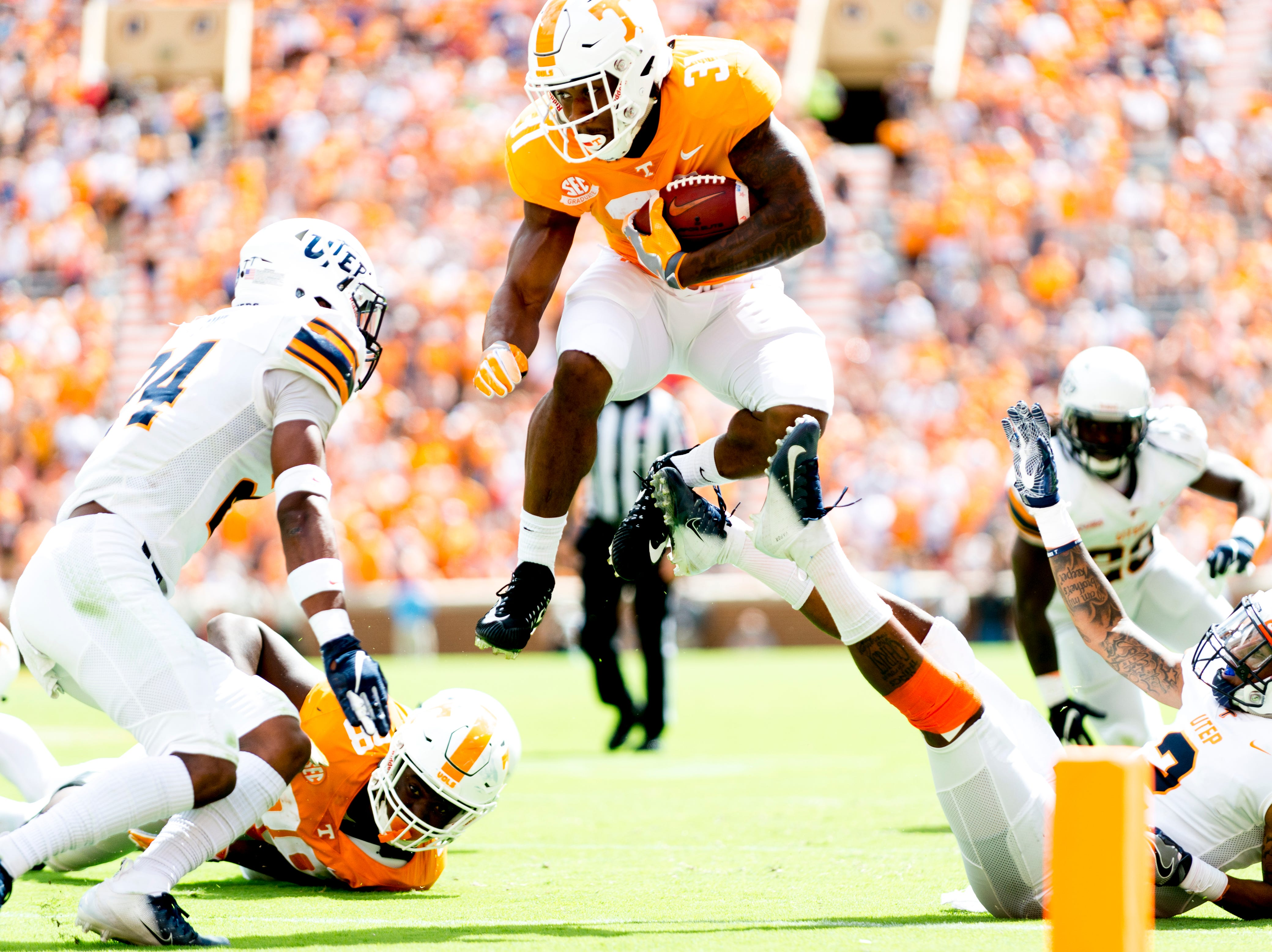 Tennessee running back Madre London (31) leaps over for extra yardage to the goal line UTEP linebacker Sione Tupou (3) during a game between Tennessee and UTEP at Neyland Stadium in Knoxville, Tennessee on Saturday, September 15, 2018.