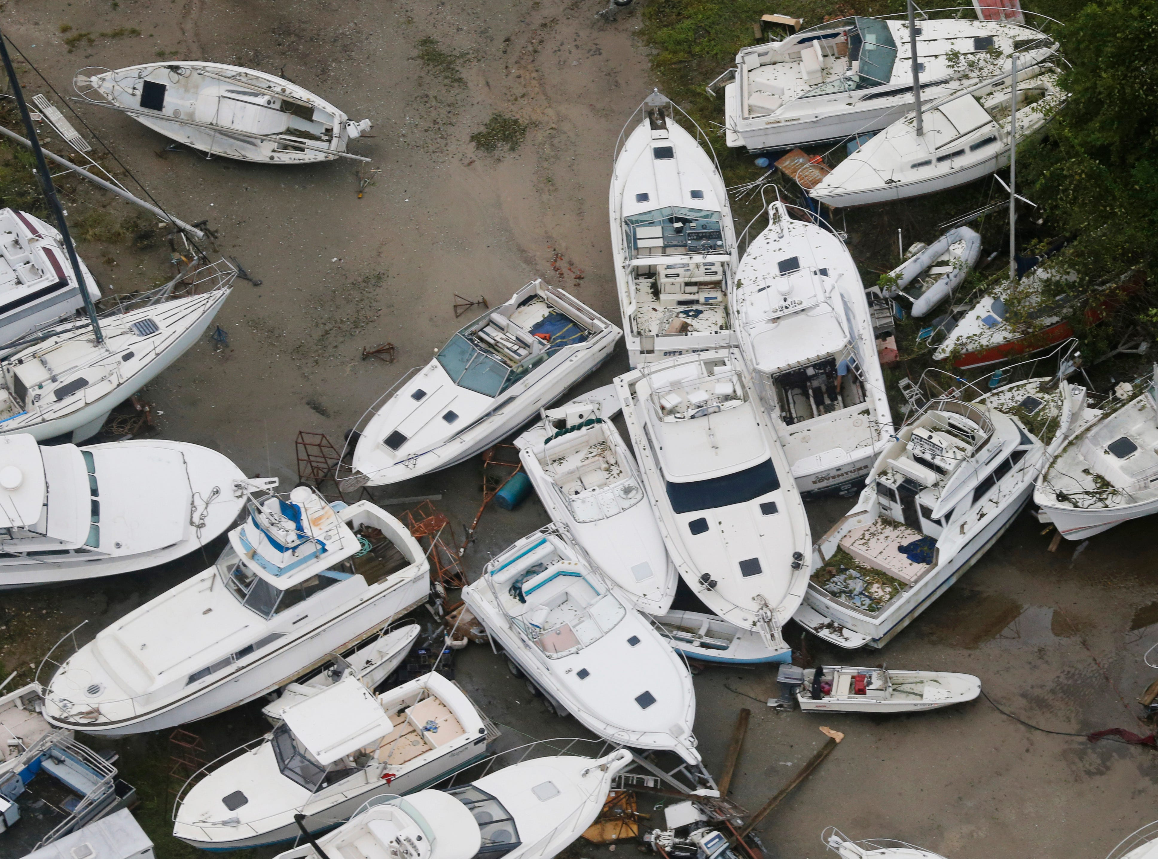 Boats are stacked up in a marina in New Bern, NC., Saturday, Sept. 15, 2018.