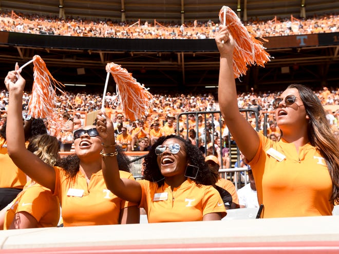 "Tennessee fans sport their orange at a Vols game earlier this season. This year, Oct.  19 will be ""Big Orange Friday"" across the state, per a proclamation from Gov. Bill Haslam."