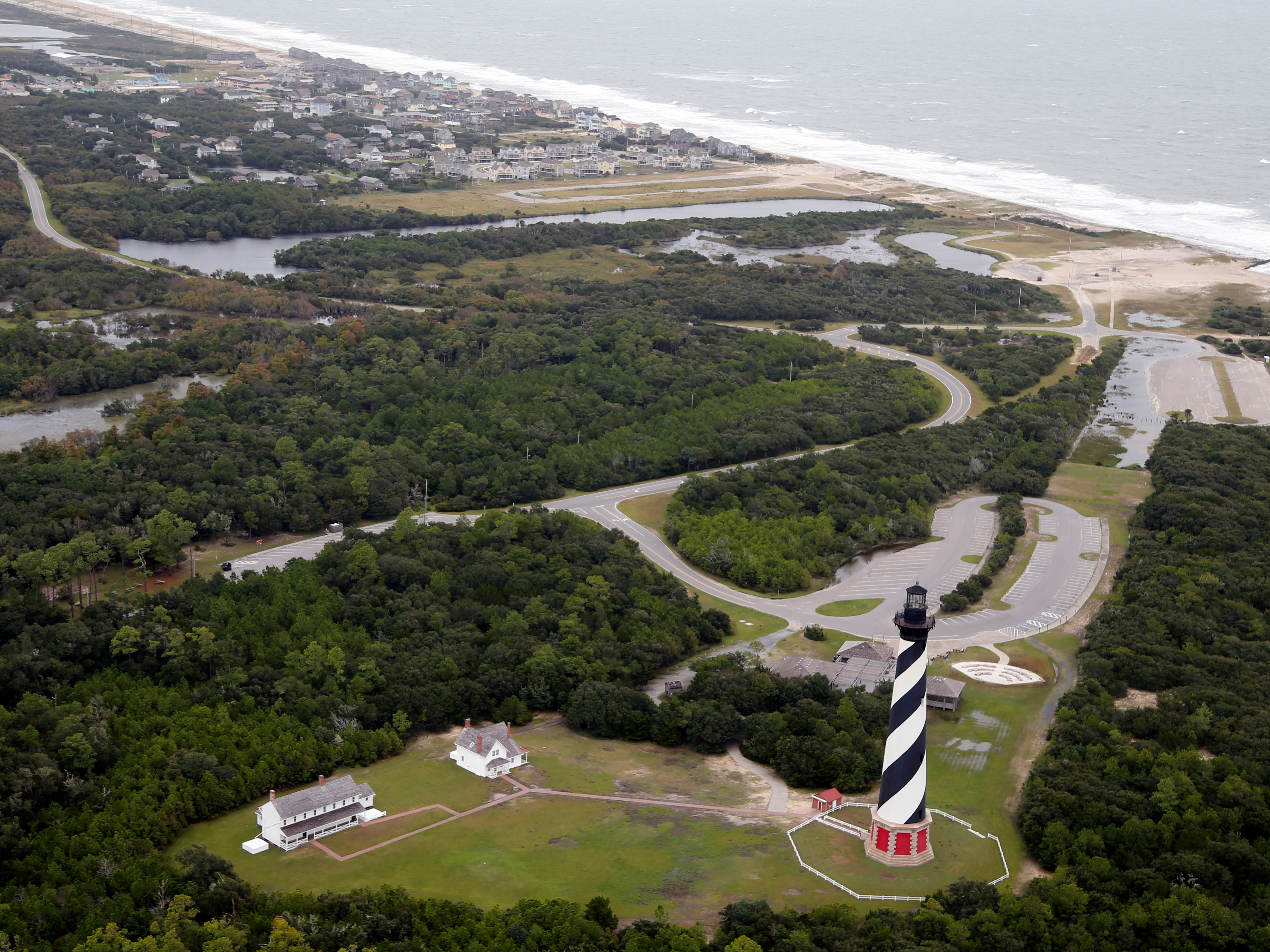 The Cape Hatteras lighthouse sits way off the beach in Buxton, NC., Saturday, Sept. 15, 2018.