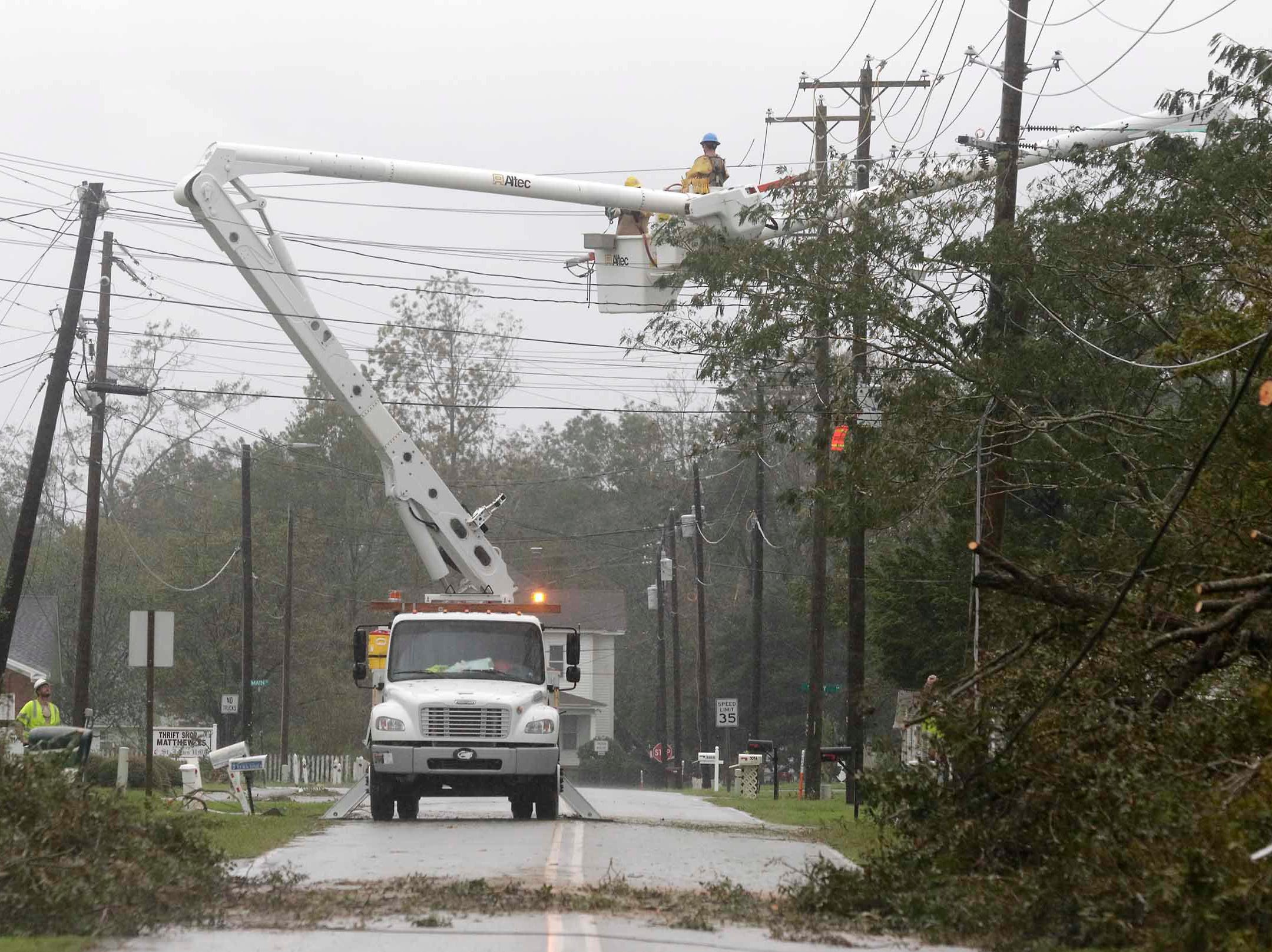 Power crews work to restore power after tropical storm Florence hit Newport N.C., Saturday, Sept. 15, 2018. A day after blowing ashore with 90 mph (145 kph) winds, Florence practically parked itself over land all day long and poured on the rain.