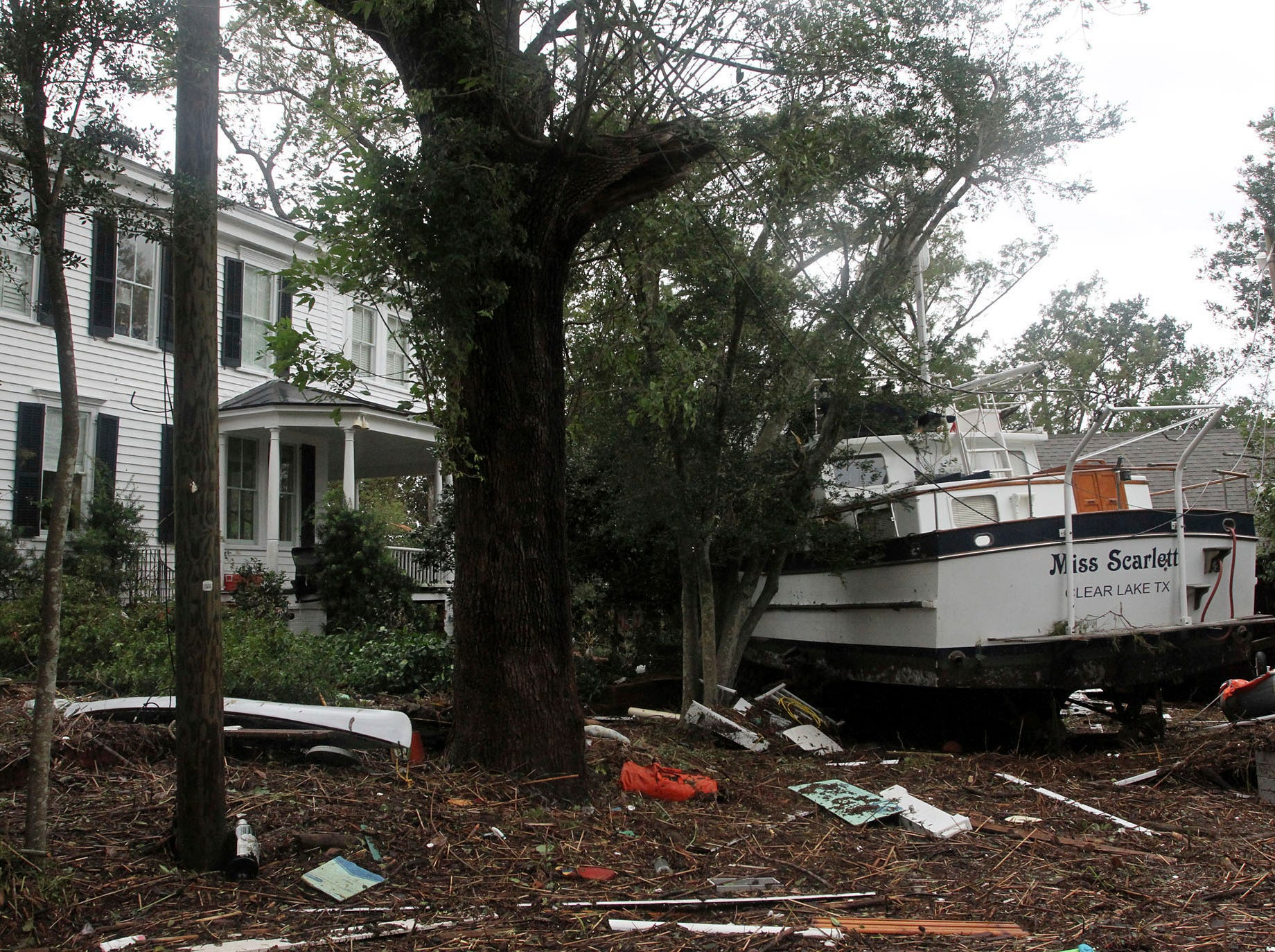 A boat rests in front of a damaged home from tropical storm Florence  in New Bern, N.C., Saturday, Sept.15, 2018.