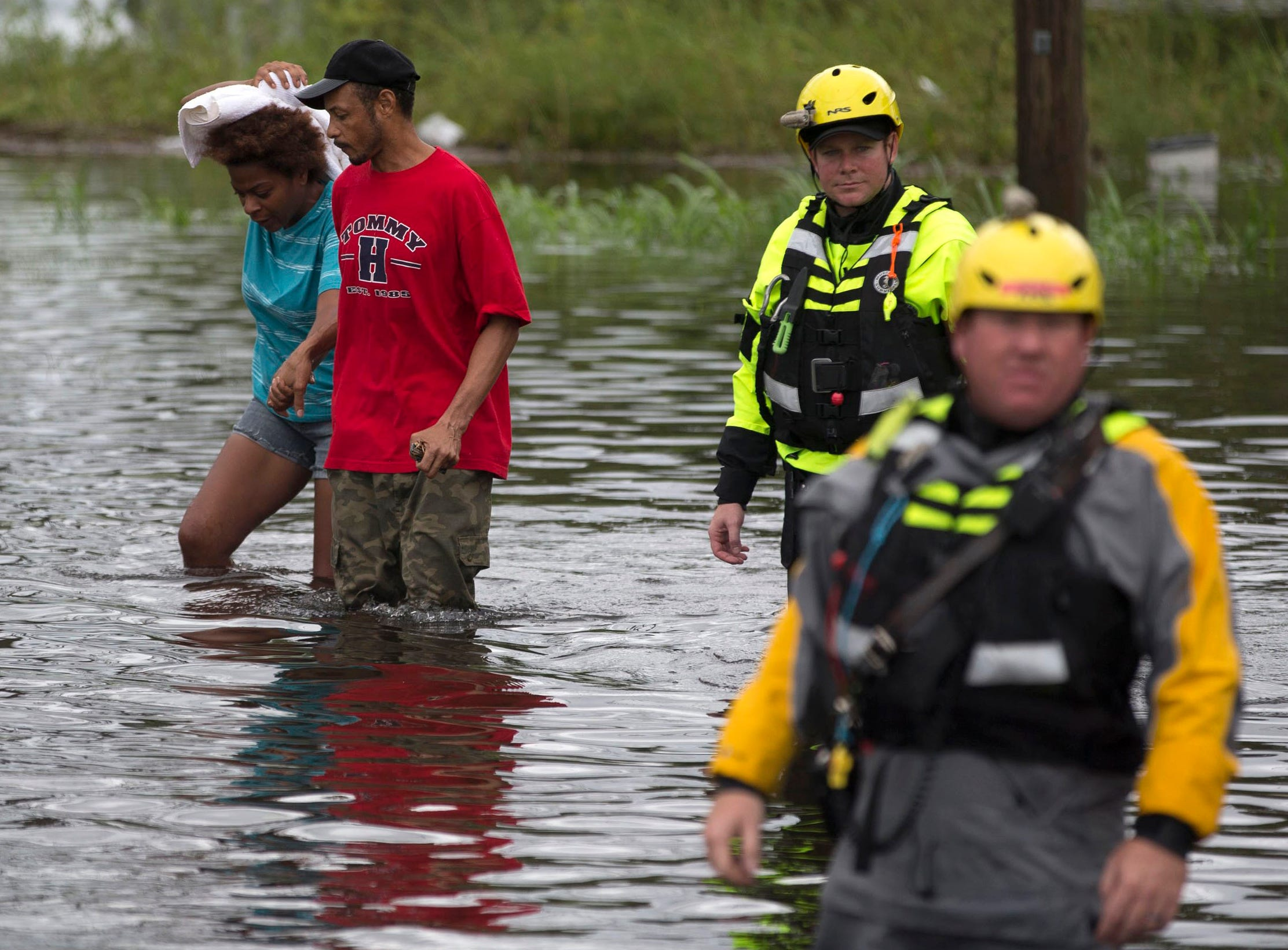 Members of the Greenville Fire Department swift water team help a couple evacuate their home following Florence, now a tropical storm, on Saturday, Sept. 15, 2018 in New Bern, N.C
