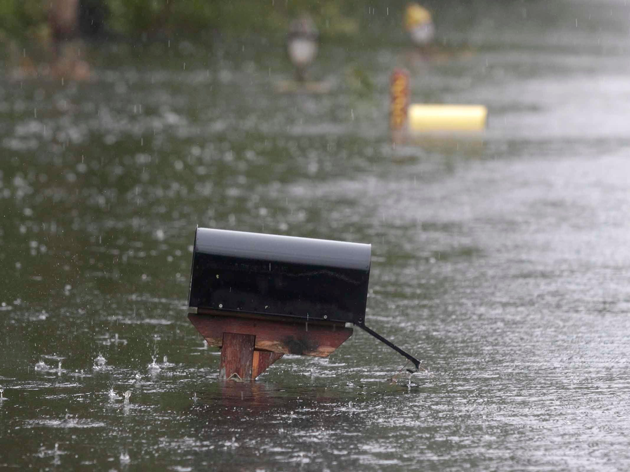 A flooded mailbox on Mill Creek Road is barely above water after Florence hit Newport N.C., Saturday, Sept. 15, 2018. A day after blowing ashore with 90 mph (145 kph) winds, Florence practically parked itself over land all day long and poured on the rain.