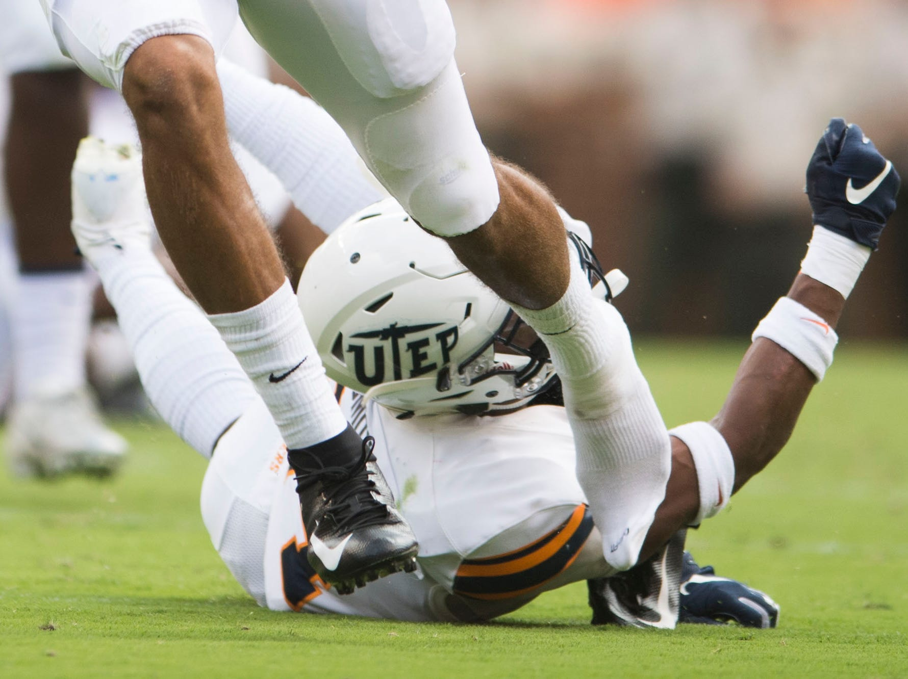 Tennessee quarterback Jarrett Guarantano (2) runs on the field after his shoe fell off during a game between UT and UTEP in Neyland Stadium Sept. 15, 2018.