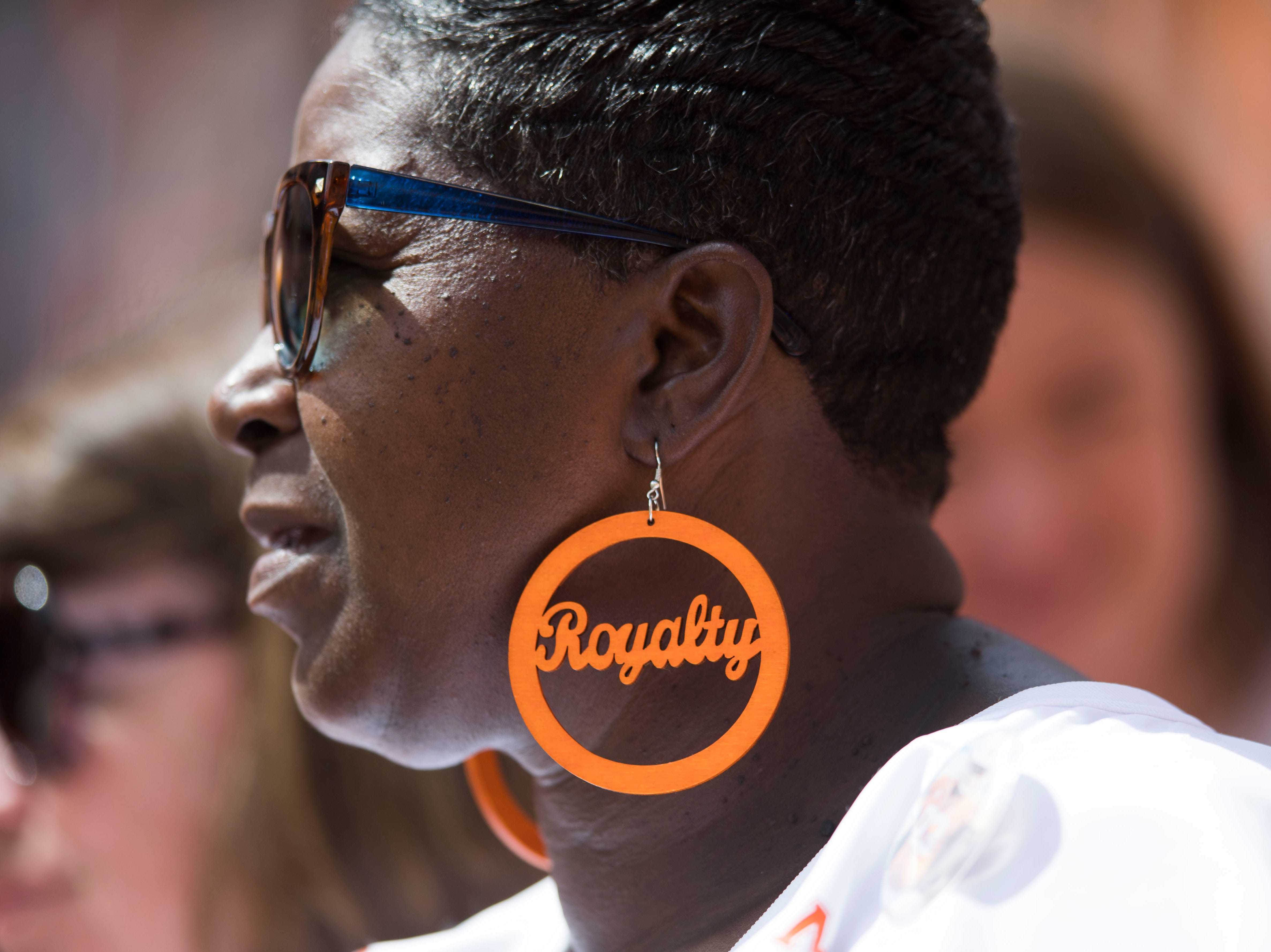 A Vols fan wears festive earrings during the second half of a game between UT and UTEP in Neyland Stadium Sept. 15, 2018.