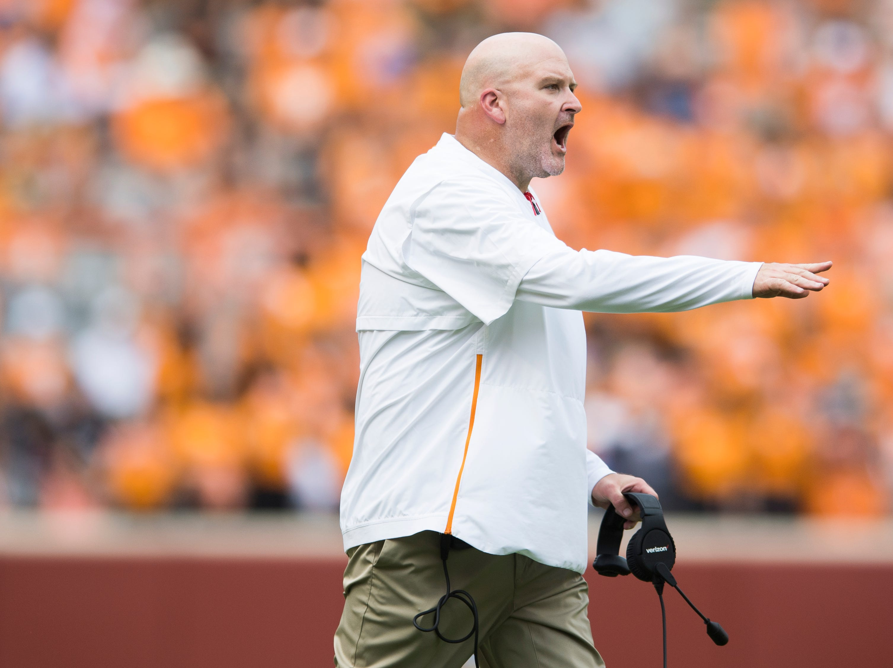 Tennessee offensive line coach Will Friend calls during a game between Tennessee and UTEP at Neyland Stadium in Knoxville, Tennessee on Saturday, September 15, 2018.