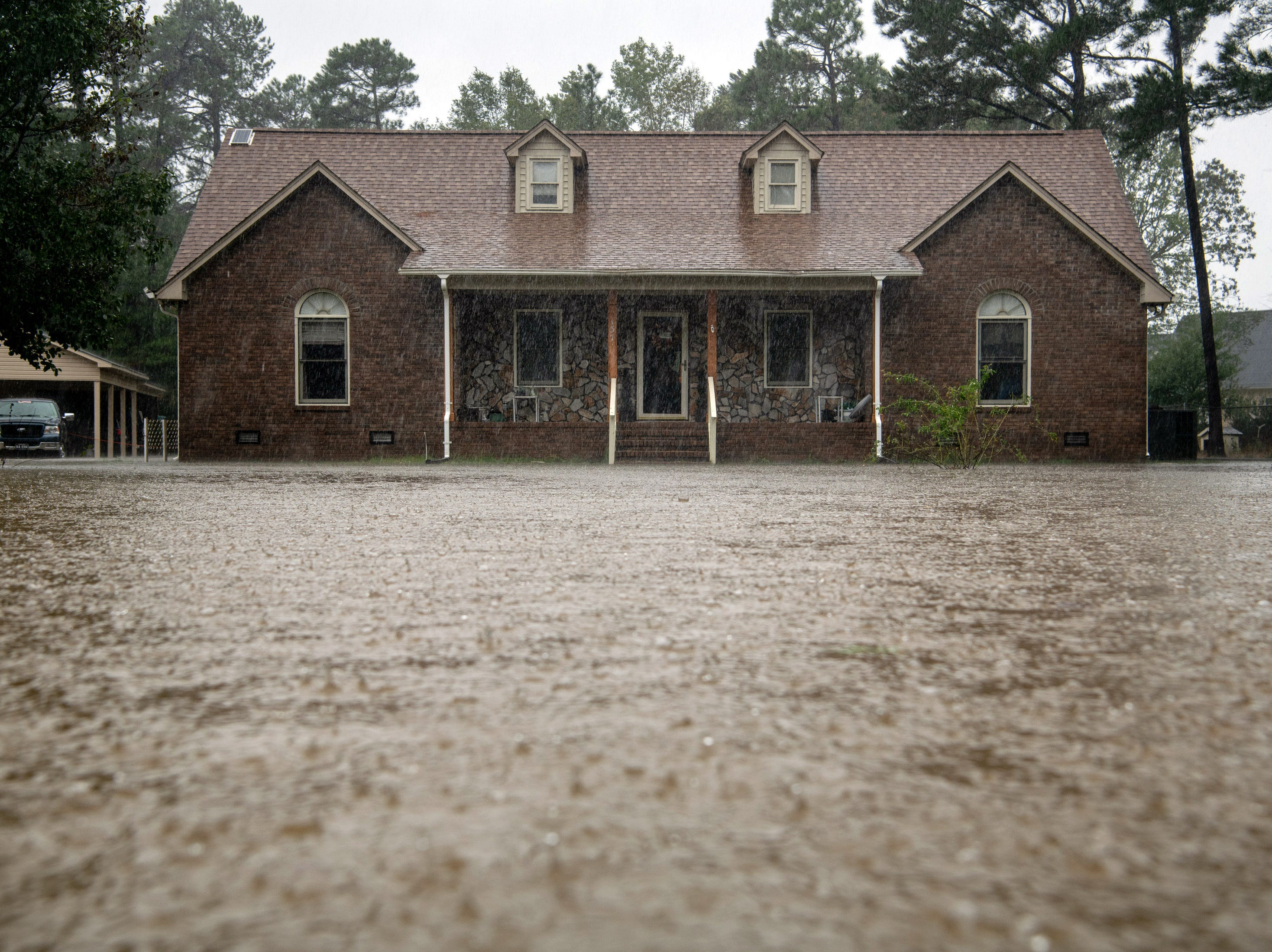September 15, 2018; Lumberton, NC, USA; Flood water reaches the home of William and Mittie Wooten as rain from Tropical Storm Florence continues to fall on Lumberton, N.C., Saturday, Sept. 15, 2018.