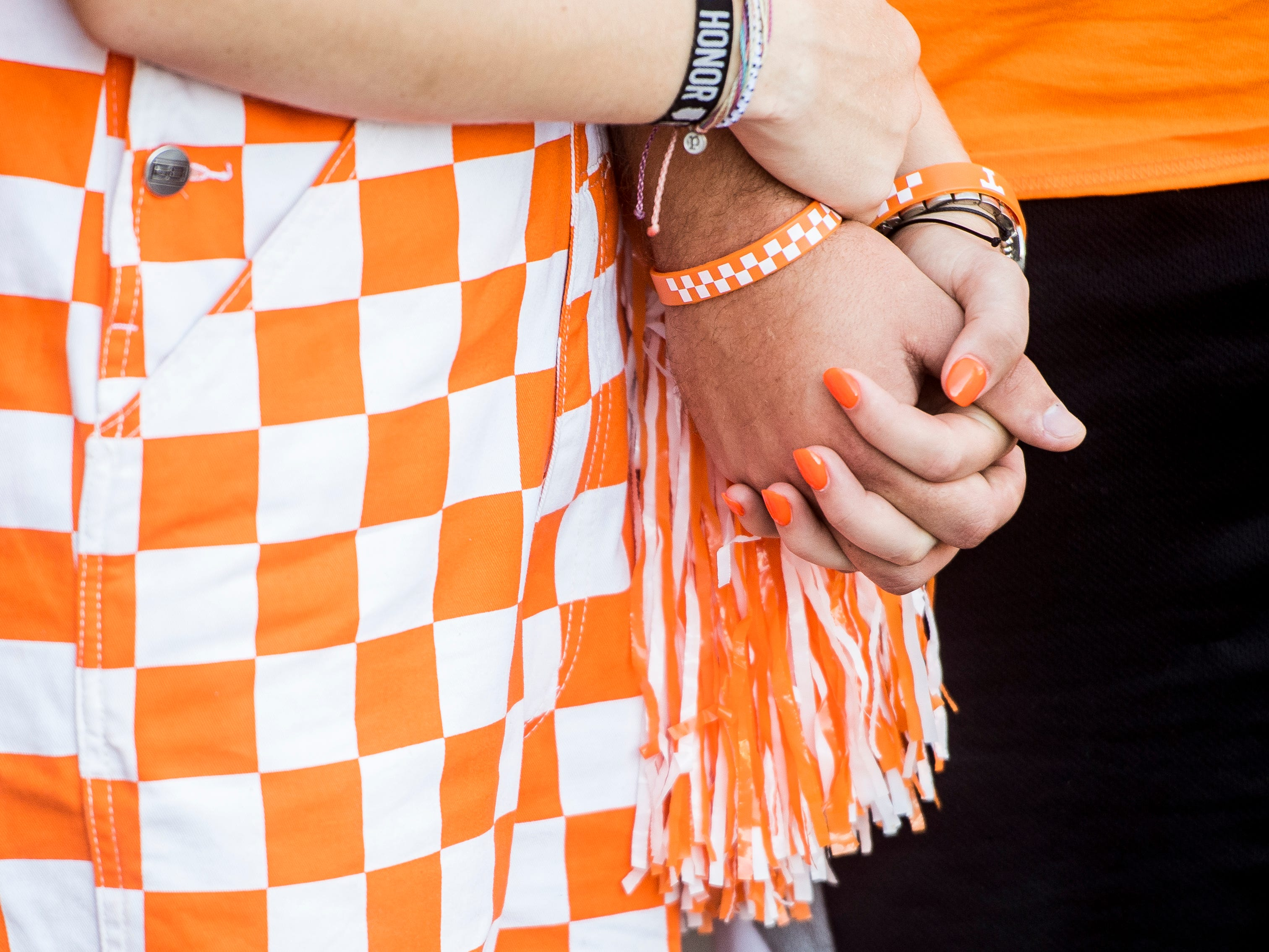 Tennessee fans hold hands during the Vol Walk before the Tennessee Volunteers' game against UTEP in Neyland Stadium on Saturday, Sept. 15, 2018.