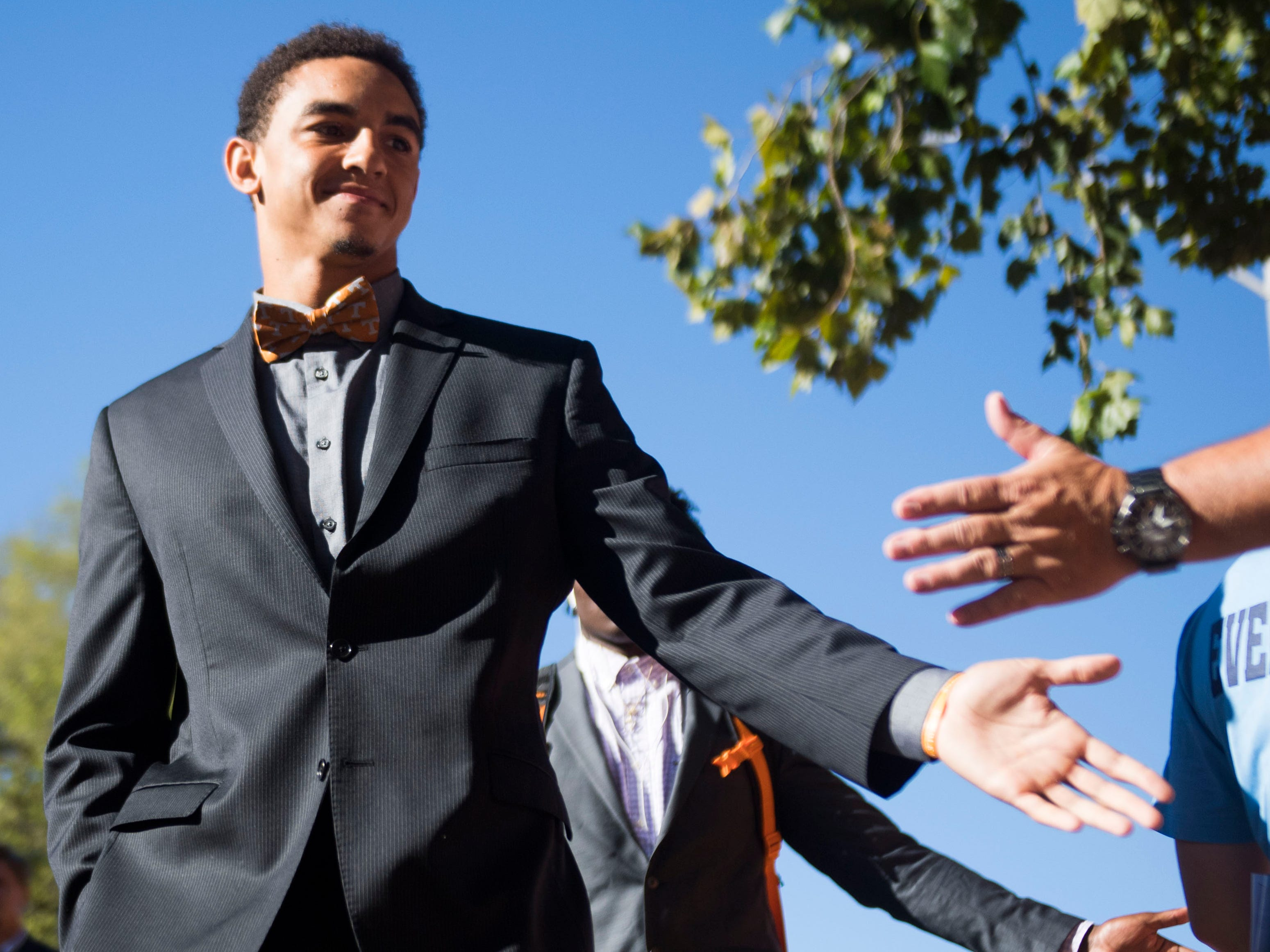 Tennessee quarterback Jarrett Guarantano (2) walks in the Vol Walk to begin outside Neyland Stadium before a game between University of Tennessee and the University of Texas at El Paso Saturday, Sept. 15, 2018.