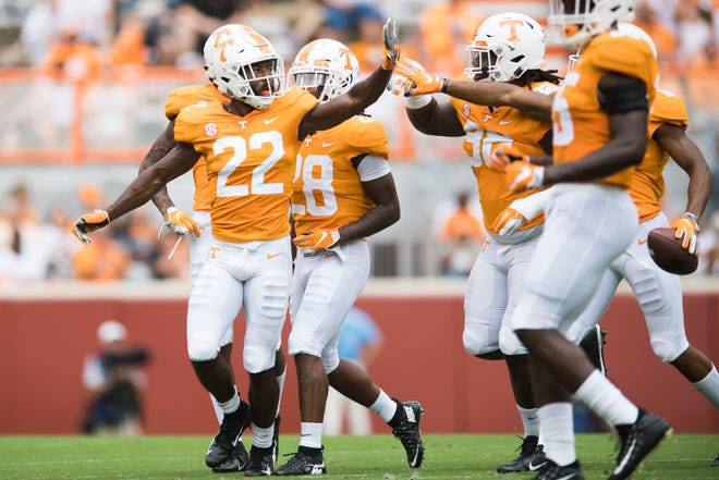Tennessee defensive back Micah Abernathy (22) celebrates a play with teammates against UTEP earlier this season.