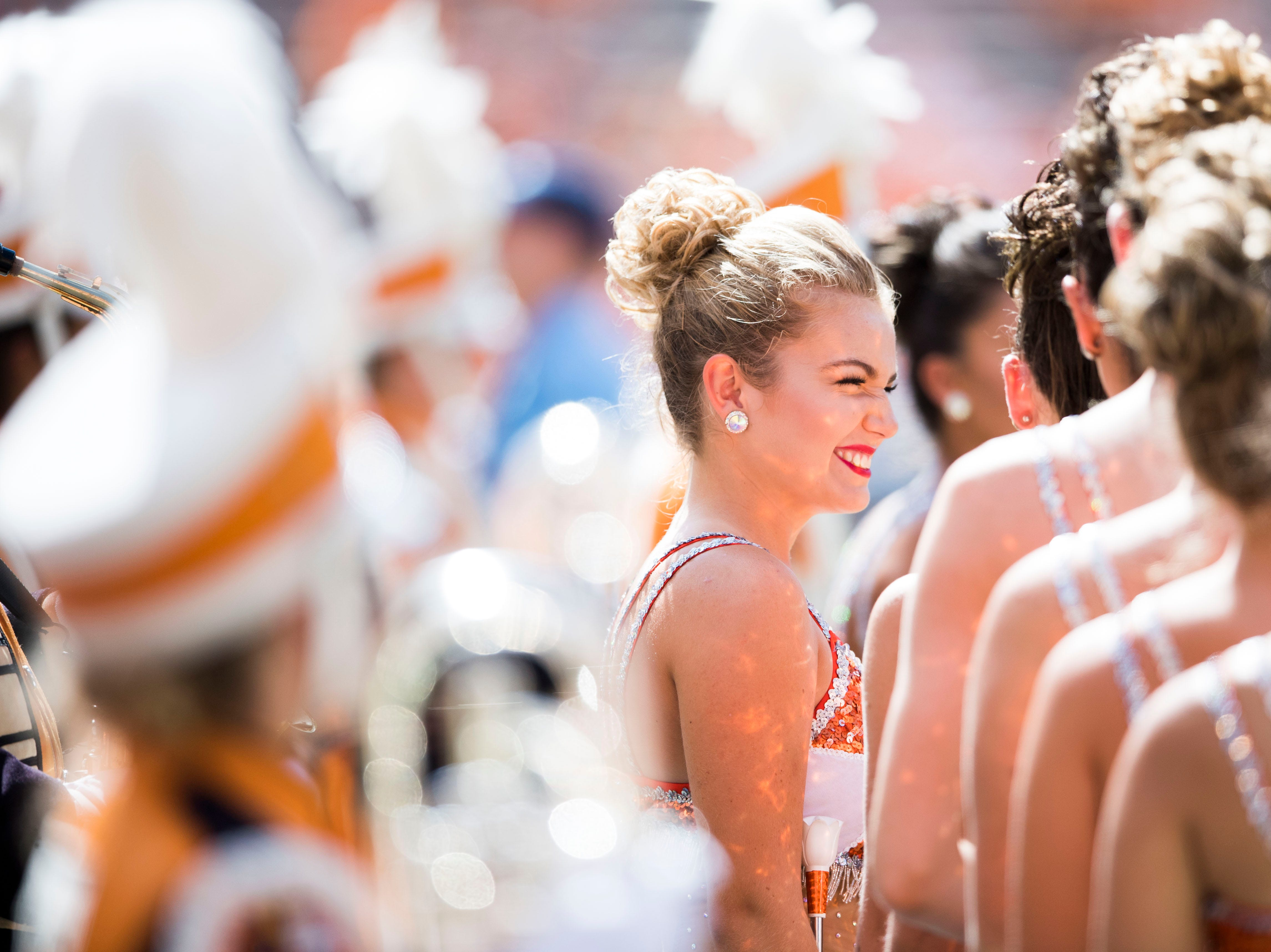 A UT majorette stands in sun before a game between UT and UTEP in Neyland Stadium Sept. 15, 2018.
