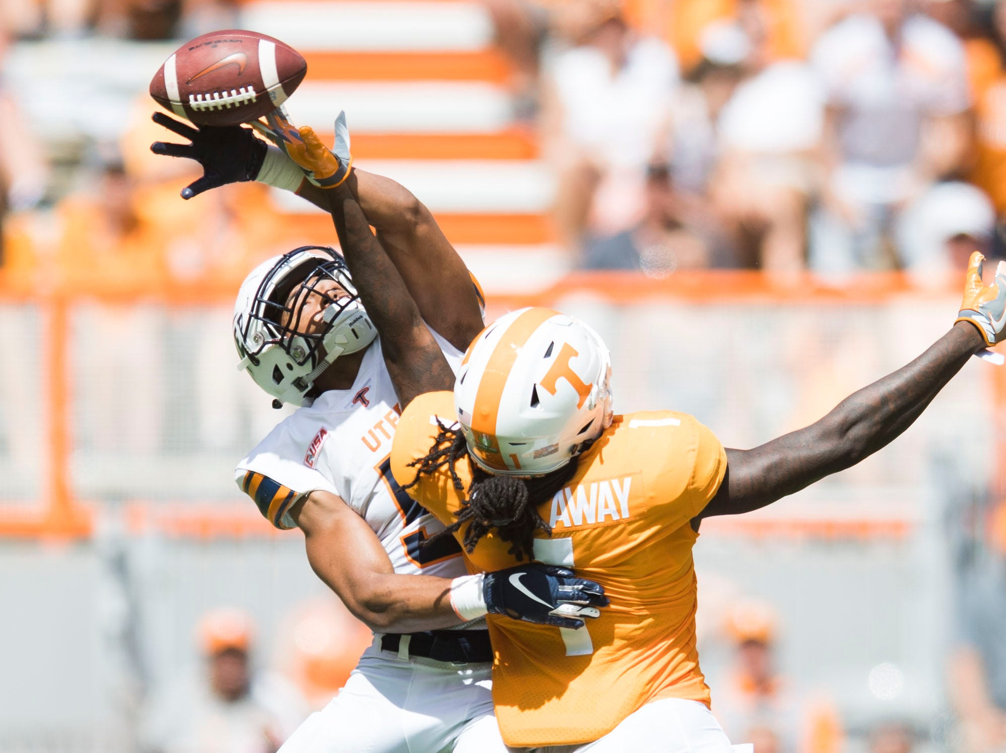 Tennessee wide receiver Marquez Callaway (1) and UTEP defensive back Nik Needham (5) collide during a play during the second half of a game between UT and UTEP in Neyland Stadium Sept. 15, 2018.