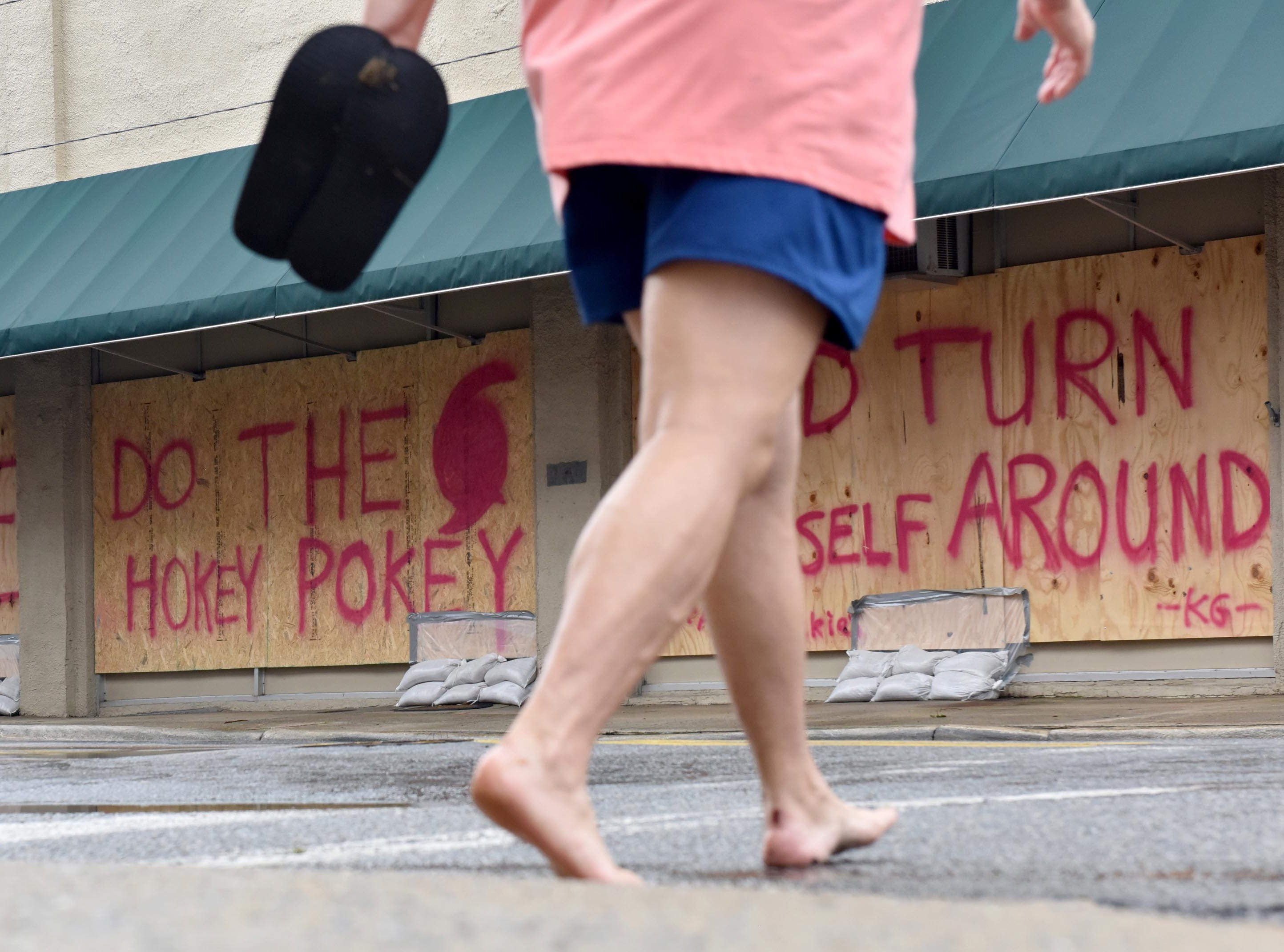 Sep 15, 2018; Washington, NC, USA; A store on E. Main Street with a message to Hurricane Florence in Washington, N.C. on Saturday morning on September 15, 2018.