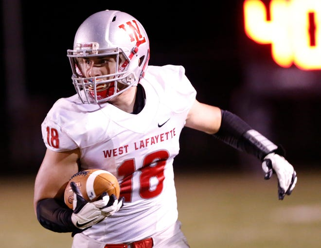 Sage Hood comes out of the West Lafayette backfield to haul in a pass against Rensselaer Friday, September 14, 2018, in Rensselaer. West Lafayette defeated Rensselaer 69-14.