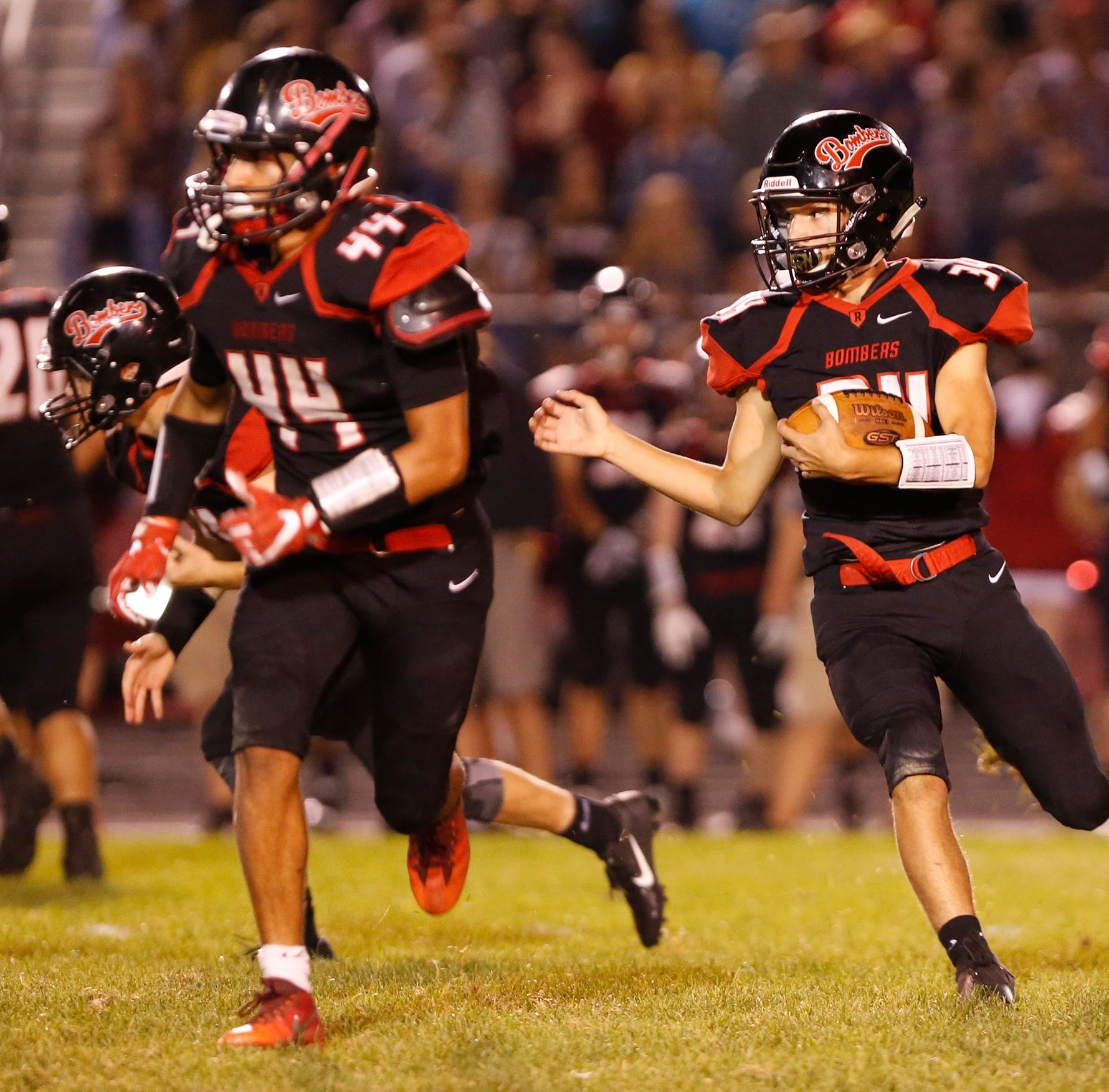 Addison Wilmington of Rensselaer runs behind the block of teammate Jose Hernandez in the third quarter against West Lafayette Friday, September 14, 2018, in Rensselaer. West Lafayette defeated Rensselaer 69-14.