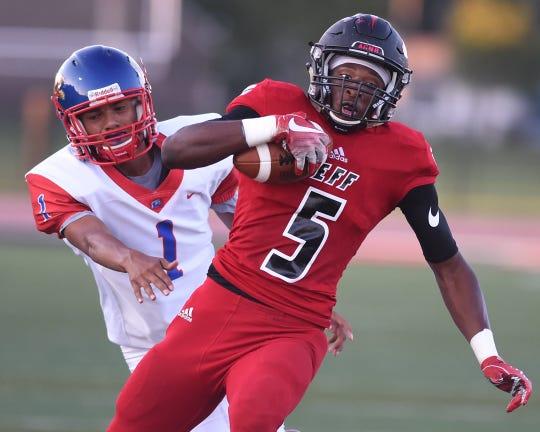 Lafayette Jeff wide receiver Brian Jenkins outruns a Kokomo defender.