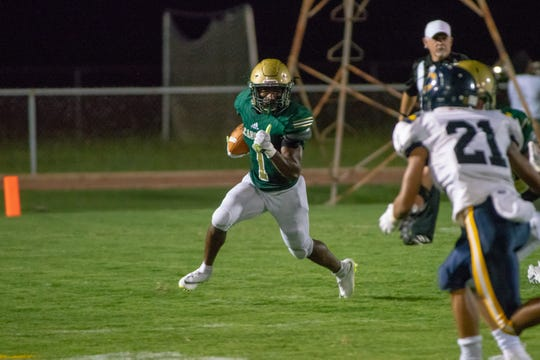 Acadiana High's Dillon Monette sprints with the ball during the play as the Acadiana Wreckin' Rams take on the Carencro Bears last season. Through his first three years on campus, Monette has rushed for 3,510 and is 1,803 yards shy of breaking the school's all-time career rushing record
