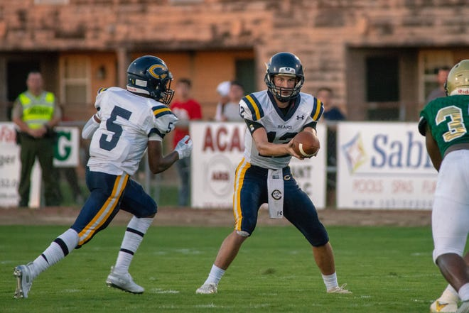 Carencro quarterback Austen Breaux, shown here handing the ball off to Theontae Allen, has become an effective multi-faceted quarterback for the Golden Bears this season.