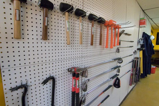 Implements of destruction range from hammers to crow bars, bats and clubs in Destruction Depot Friday, Sept. 14, 2018.