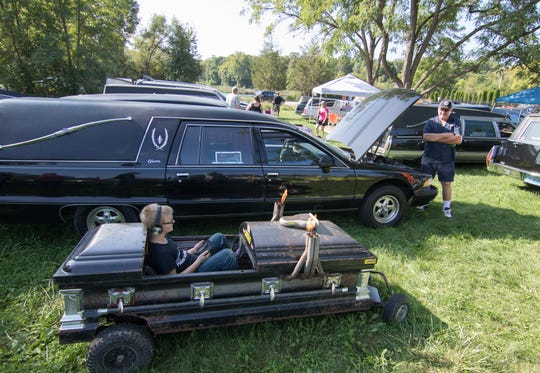 Eight-year-old David Boykin sits in his dad Kenny's go-kart Saturday, Sept. 15, 2018. About 65 hearses showed up despite the annual festival being cancelled over a disagreement with township officials.