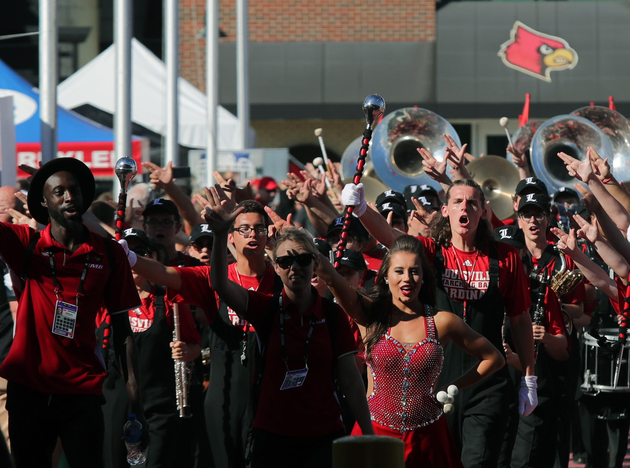 The Louisville Marching Band entertains the crowd before the Card March.