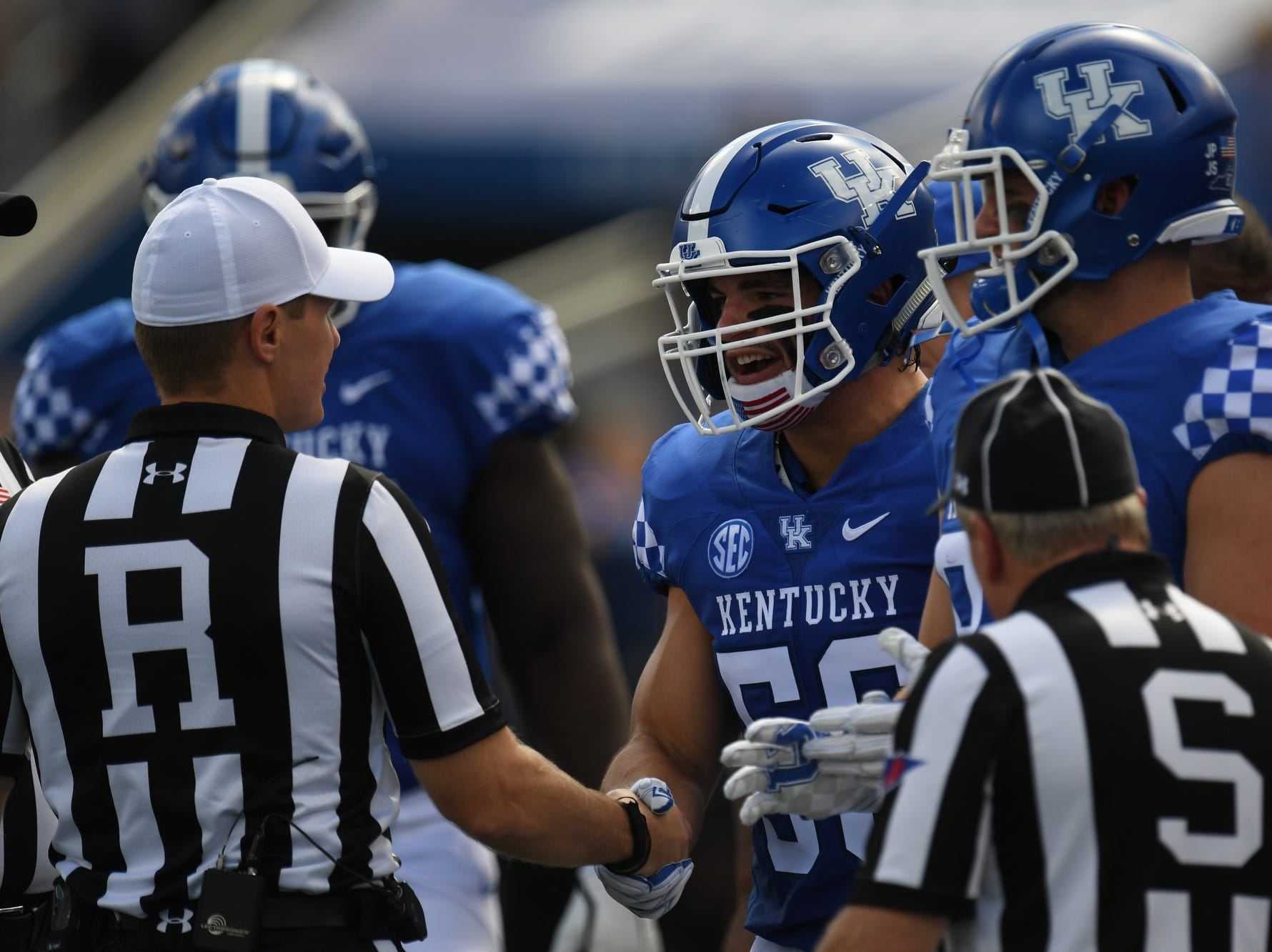 UK captain Kash Daniel shakes hands with the referee during the University of Kentucky football game against Murray State at Kroger Field in Lexington, Kentucky on Saturday, September 15, 2018.