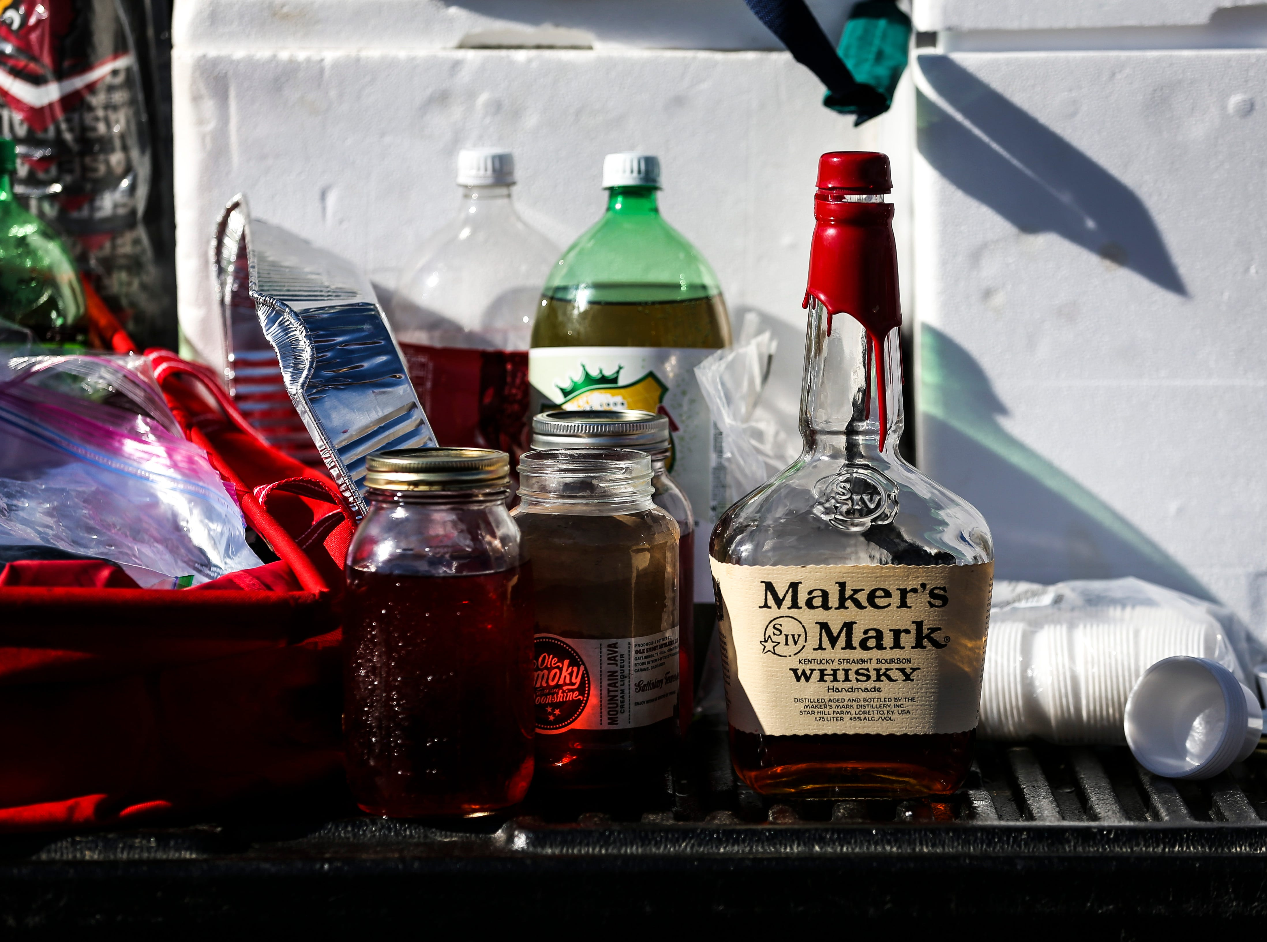 Some fans brought in some Kentucky essentials such as bourbon for tailgating before the Cardinals' game against Western Kentucky Saturday, Sept. 15, 2018.
