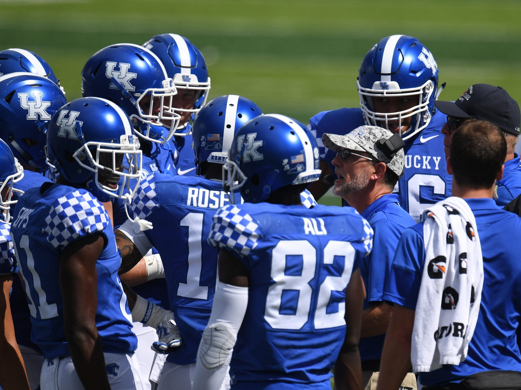 UK assistant head coach Eddie Gran talks to some players during the University of Kentucky football game against Murray State at Kroger Field in Lexington, Kentucky, on Saturday, Sept. 15, 2018.