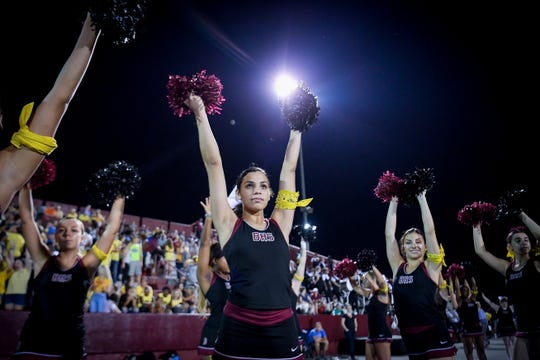 Ballard cheerleaders prepare for for a kickoff during the football game played against DuPont Manual at Ballard High School in Louisville, Ky, Friday, Sep. 14, 2018