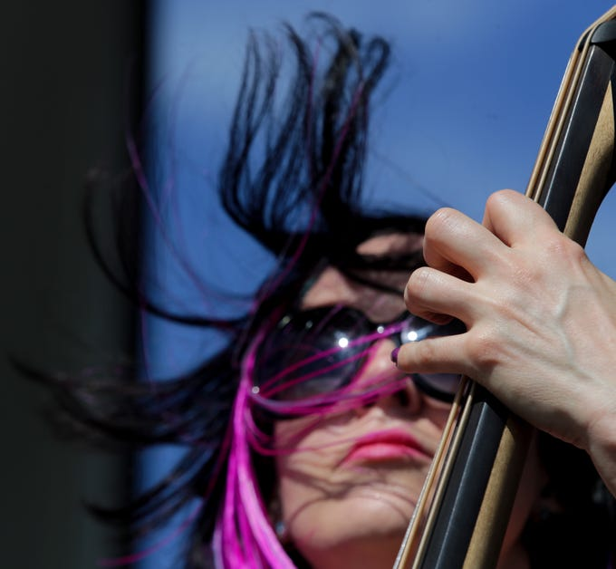 Verity Vice, with Vice Tricks, plays the double bass during their performance at Kentucky Kick Down. 