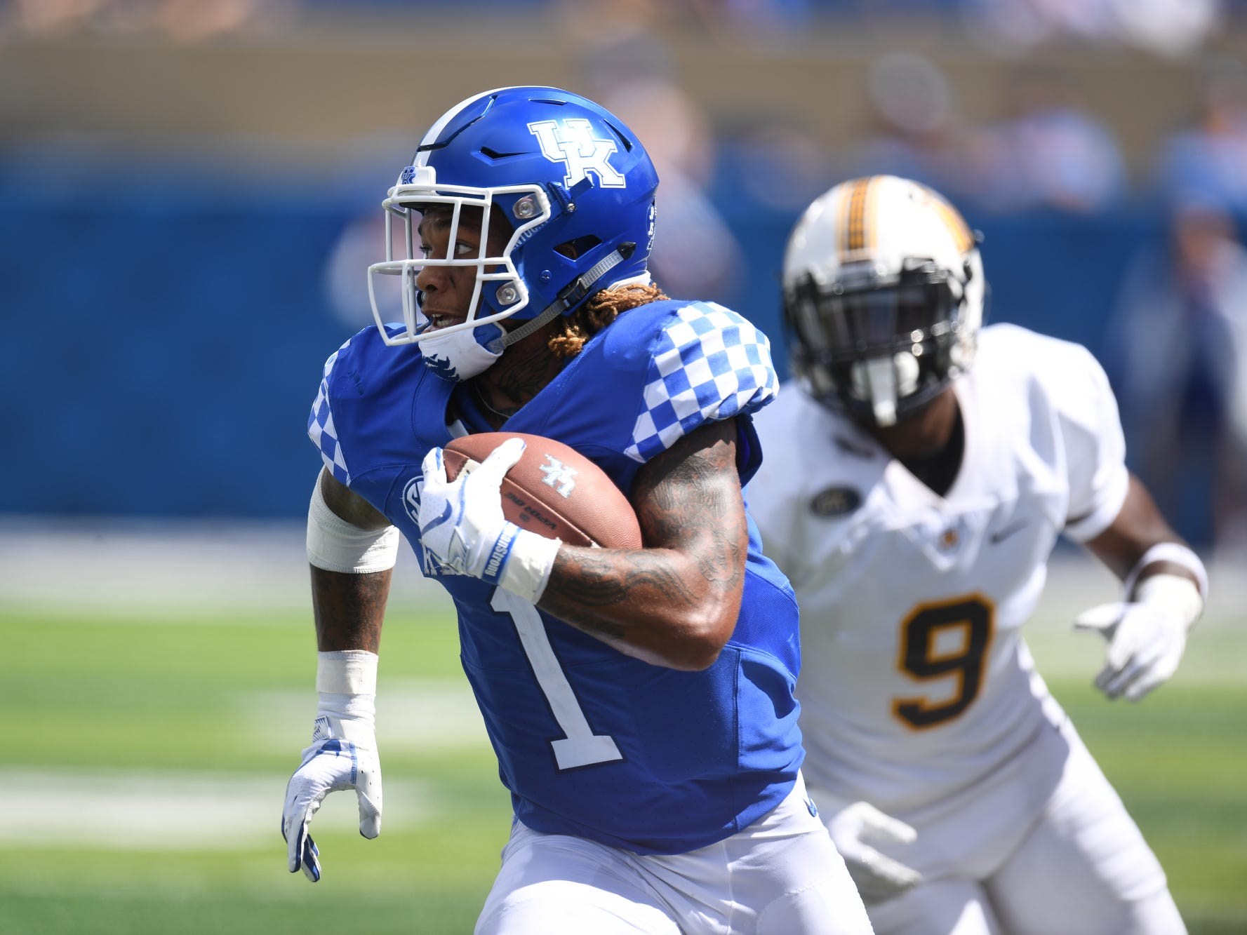 UK wide receiver Lynn Bowden Jr. runs after the catch during the University of Kentucky football game against Murray State at Kroger Field in Lexington, Kentucky, on Saturday, Sept. 15, 2018.