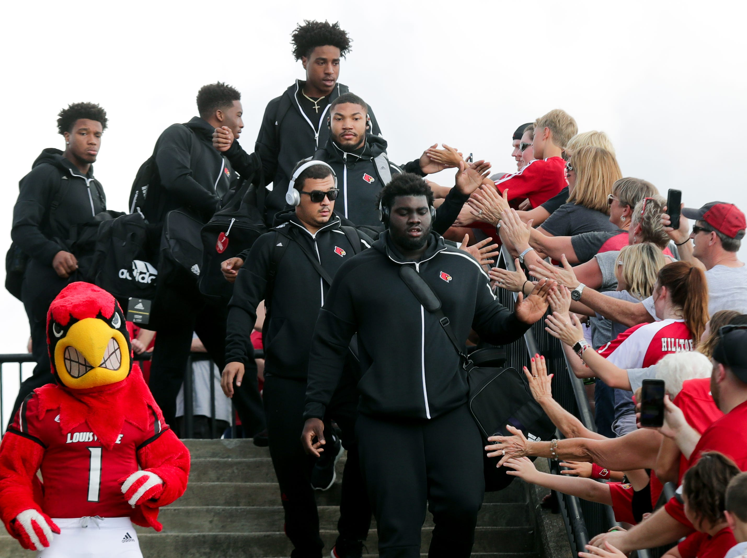 Fans greet the Louisville football team during the Card March.