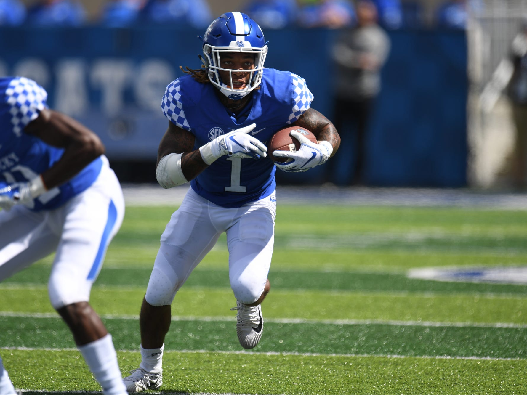 Kentucky wide receiver Lynn Bowden Jr. runs with the ball during the University of Kentucky football game against Murray State at Kroger Field in Lexington, Kentucky, on Saturday, Sept. 15, 2018.