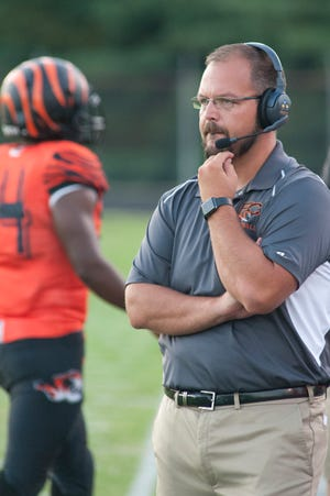 Fern Creek head football coach Joshua Abell watches his team perform during the Fern Creek vs. DeSales football game at Fern Creek.