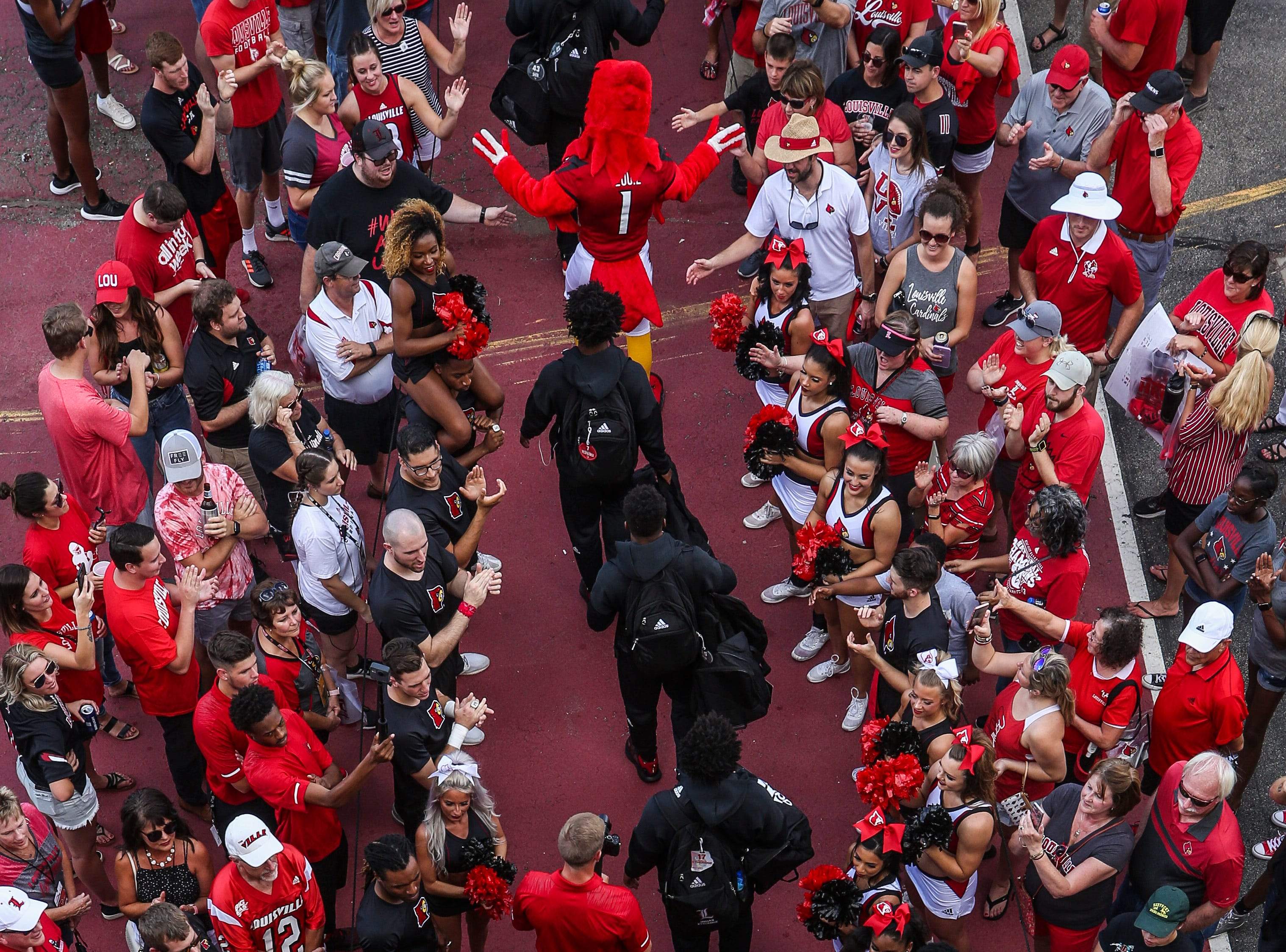 The U of L football team greets fans before the Cardinals' game against Western Kentucky Saturday, Sept. 15, 2018. Last week's Cards March was cancelled due to bad weather.
