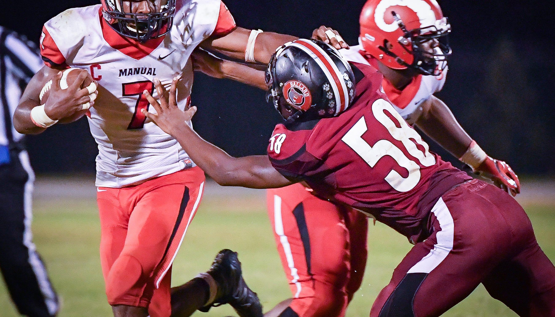 louisville high school football: manual defense carries team