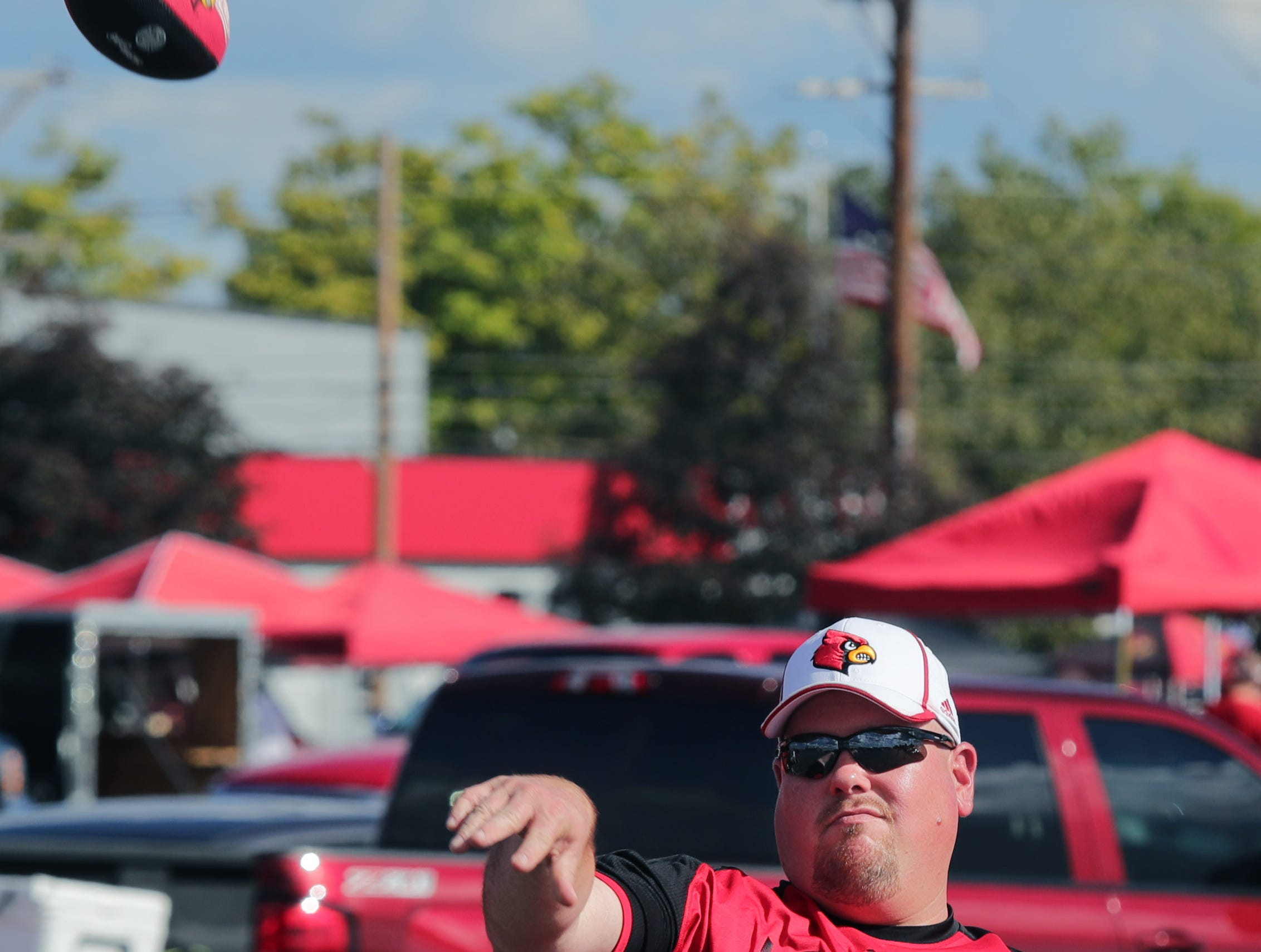 Fans tailgate before the Louisville vs Western Kentucky game on Saturday. 